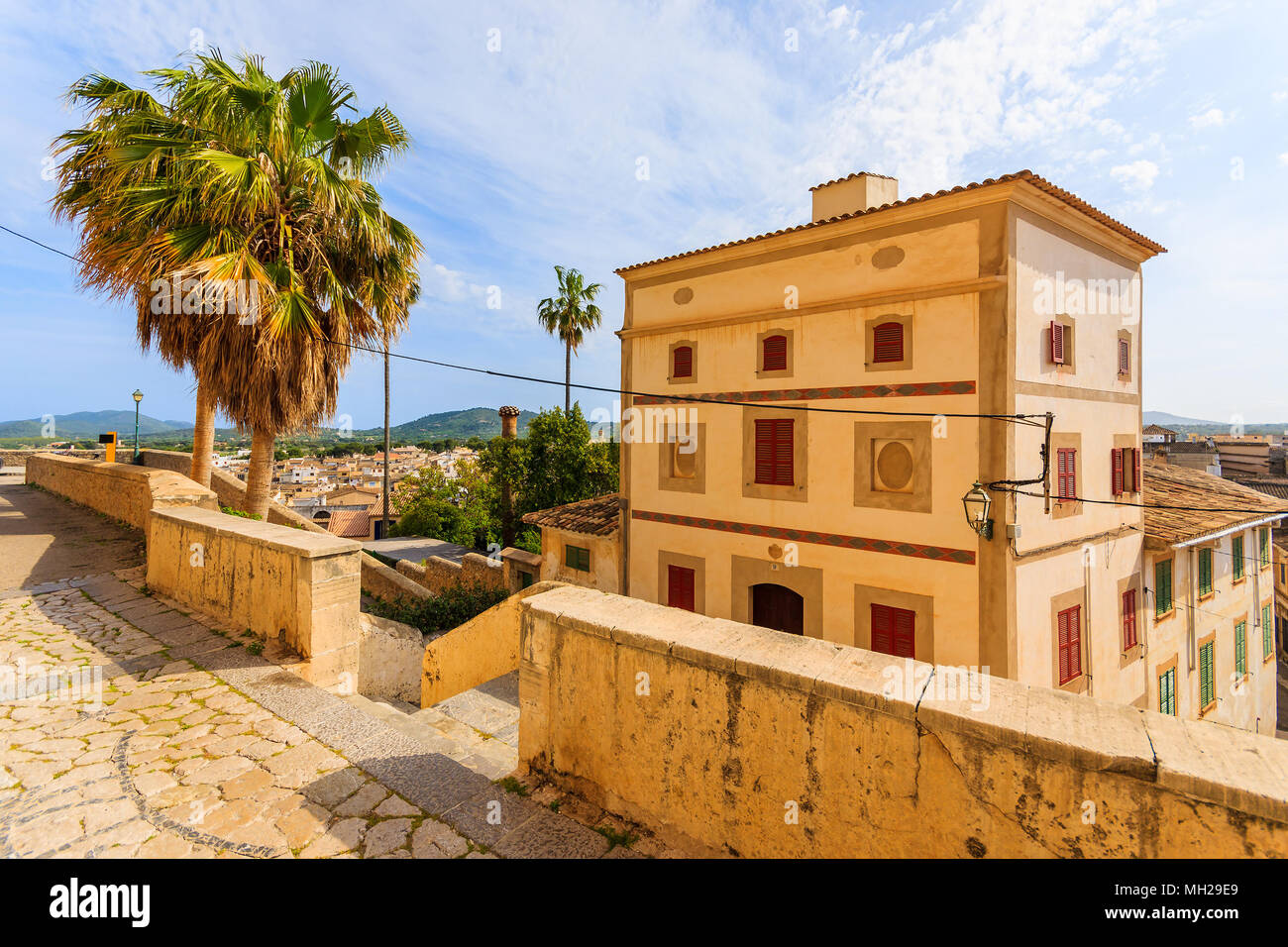 Street with typical beautiful house in historic Arta town, Majorca island, Spain - Stock Image