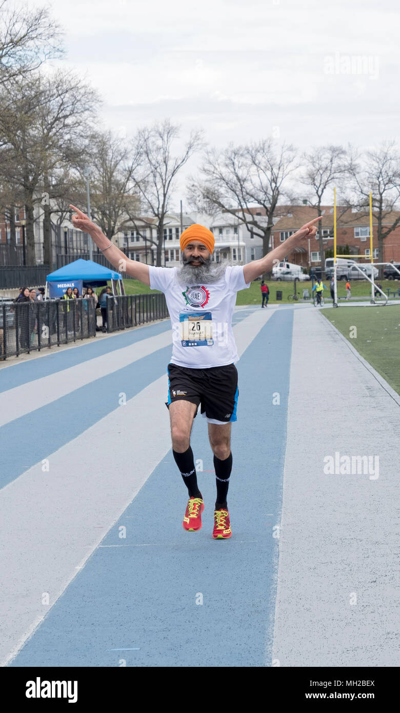 A Sikh man finishing third at the Vaisakhi 5k run in VIctory Field, Woodhaven, Queens, New York. - Stock Image