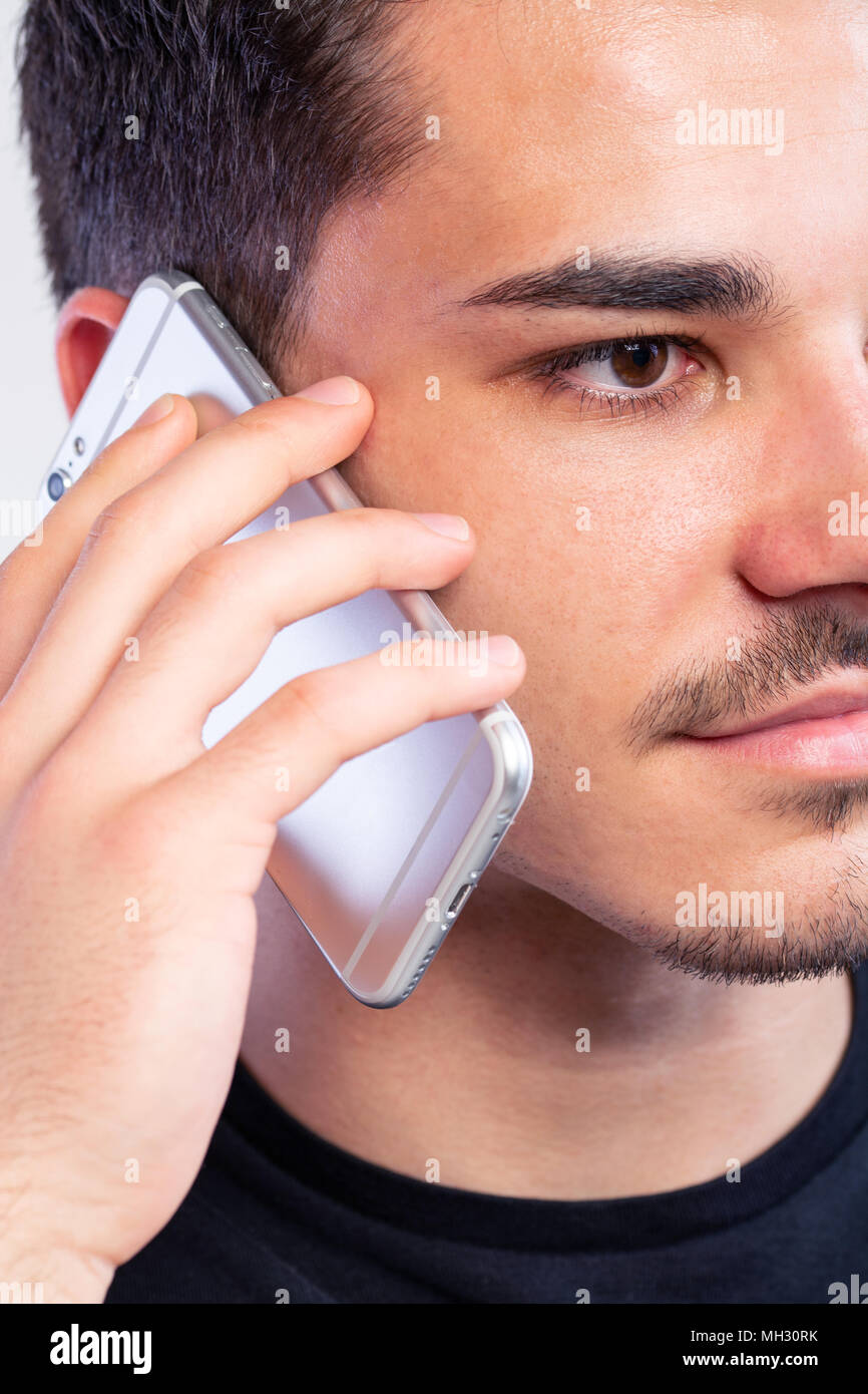a young man with black using the phone, hand grabing a phone Stock Photo