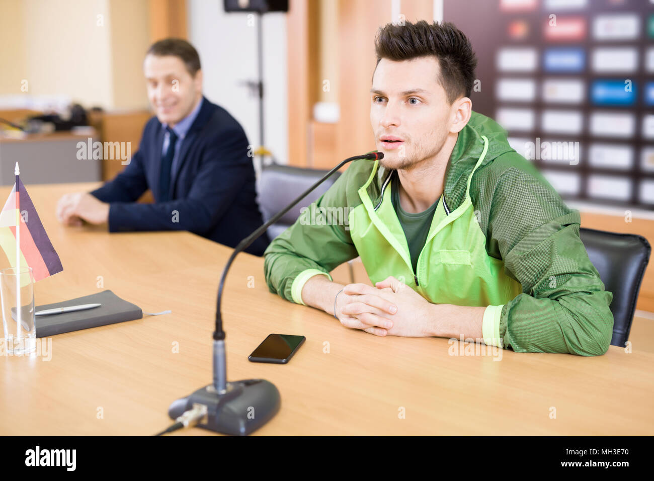 Young Sportsman at Press Conference - Stock Image