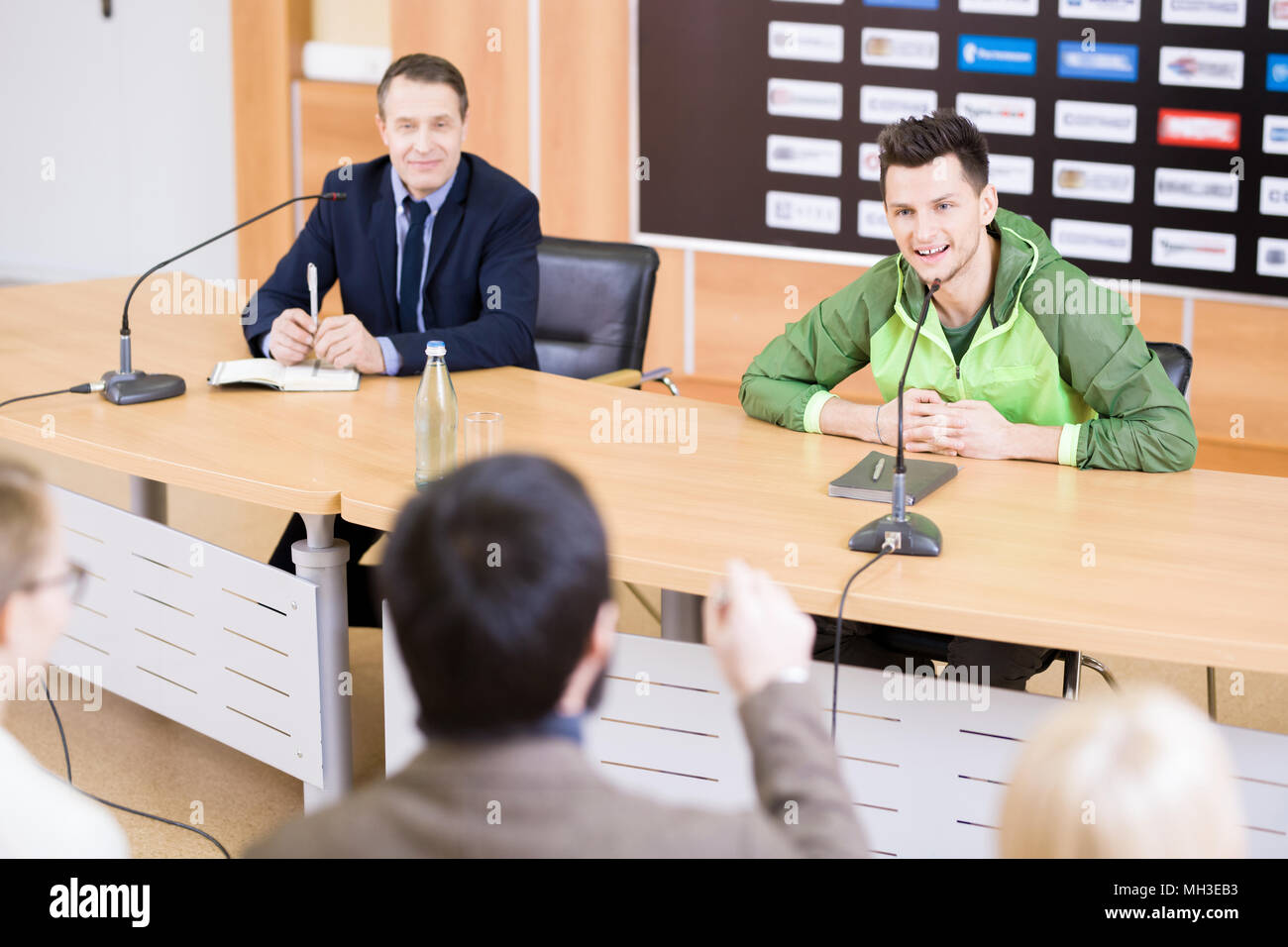 Sportsman Answering Questions at Press Conference - Stock Image