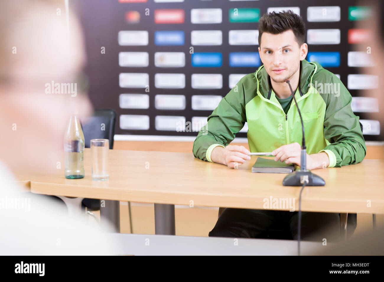 Famous Sportsman at Press Conference - Stock Image