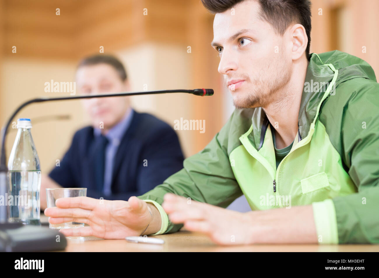Handsome Sportsman Speaking  at Press Conference - Stock Image