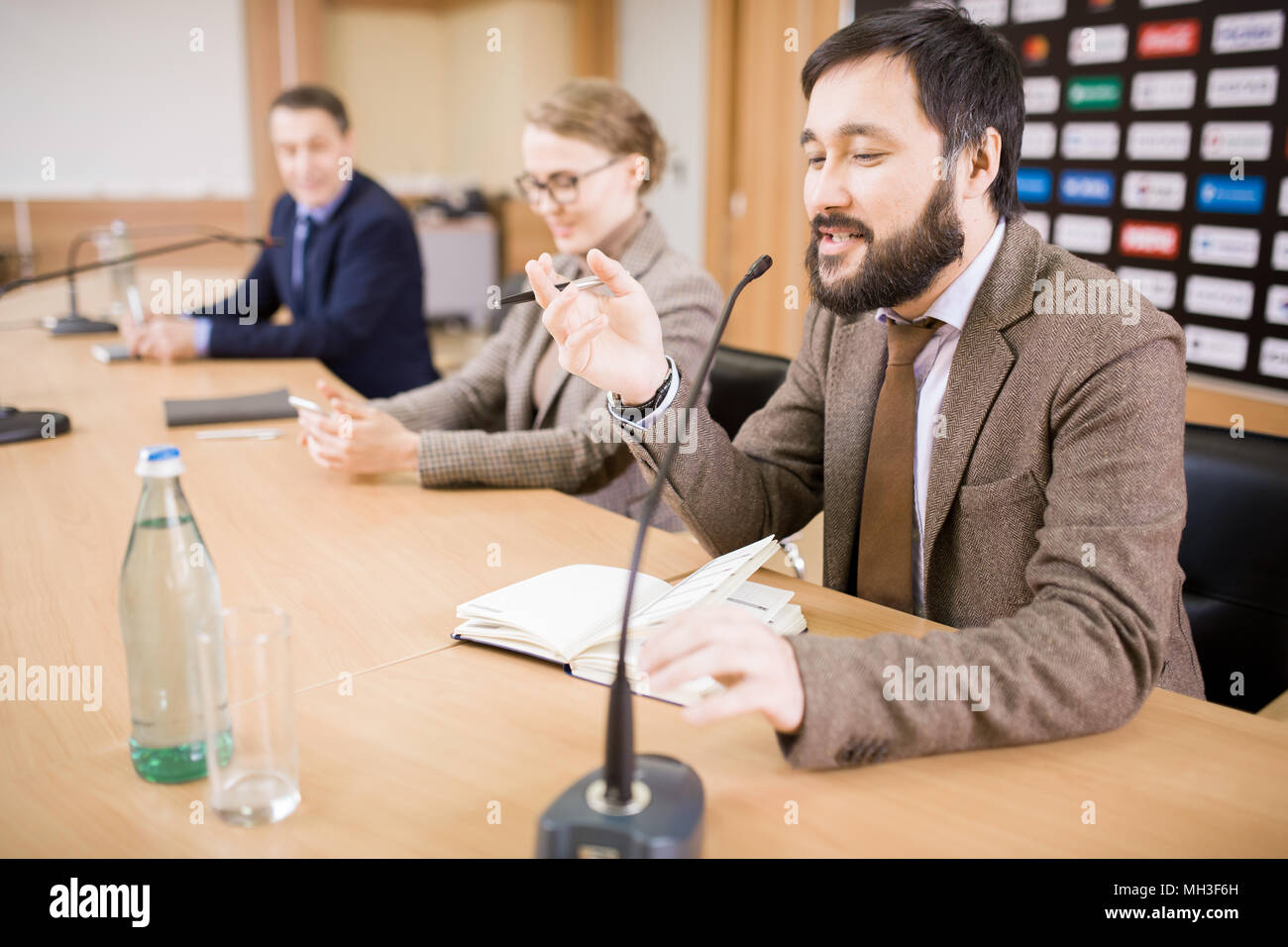 Business People at Press Conference - Stock Image