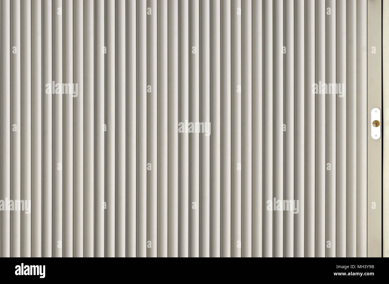 The Texture Of The Shutter Door Or Window In Light Gray Color. Metal Gates  Or Shutters For Garage Or Shop, Metal Sheet Texture, Steel Rolling Shutter