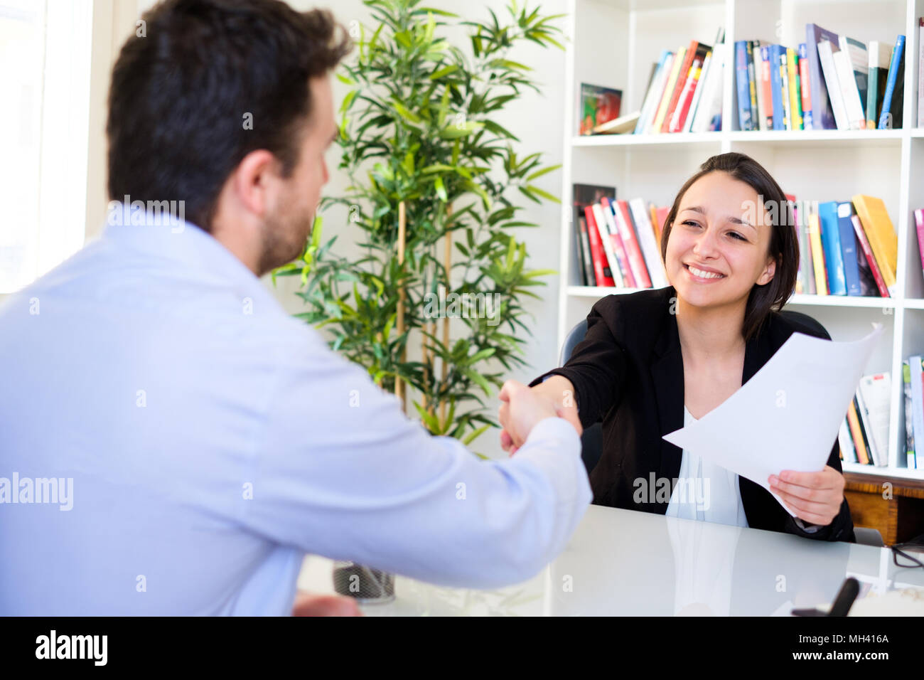 Young candidate handshake after successful job interview - Stock Image