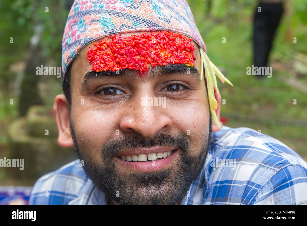 Gorkha,Nepal - Sep 30,2017: Portrait of a happy nepali man at dashain festival in Nepal. - Stock Image