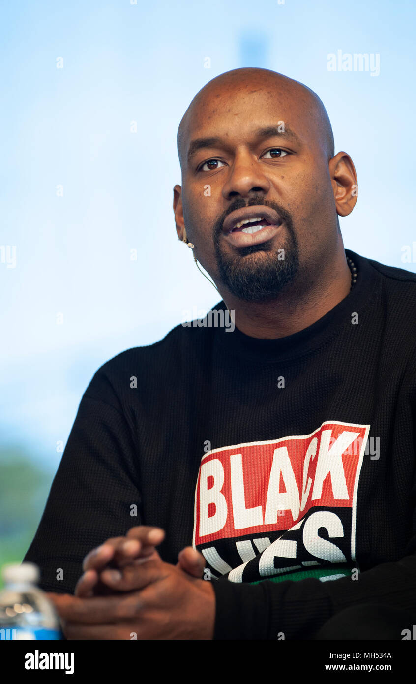 4-21-2018, SPRINT Pavilion, Charlottesville, VA, USA. President of Black lives Matter of Greater New York, Hawk Newsome, speaking during Listen First in Charlottesville.  Listen First was part of the first National Week of Conversation (April 20-28, 2018).  Listen First's weekend events in Charlottesville, VA, were created to support healing and reconciliation after 2017 white supremacist and pro-confederacy protests left one woman dead and a community divided.  A small number of seats of the 3,500 seat amphitheater were occupied on Saturday as speakers and panel discussions were presented. - Stock Image