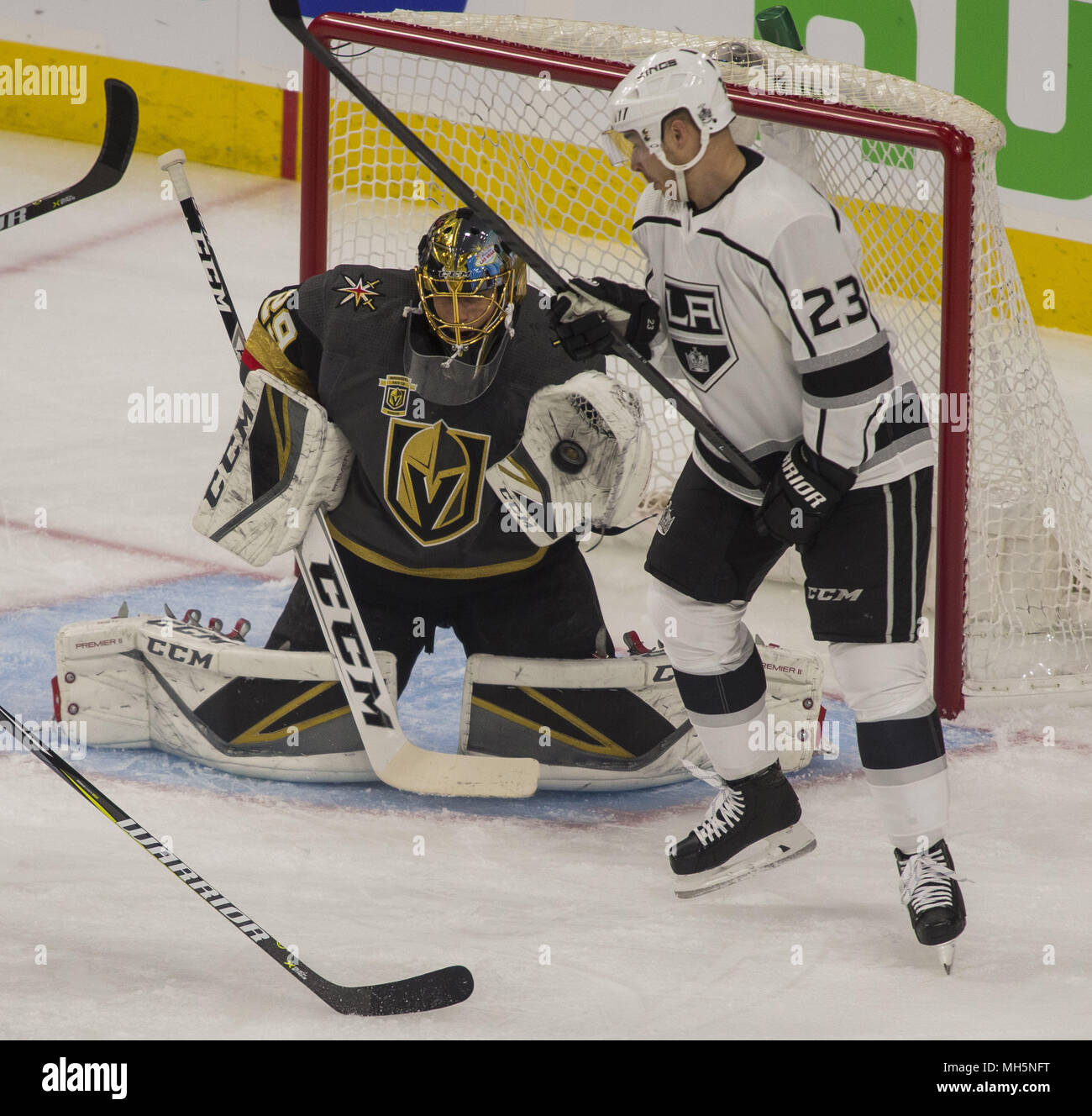 Vegas Golden Knights goaltender Marc-Andre Fleury (29) nabs a shot on goal  with Los Angeles Kings right wing Dustin Brown (23) nearby during their  first ... 9a164e12c