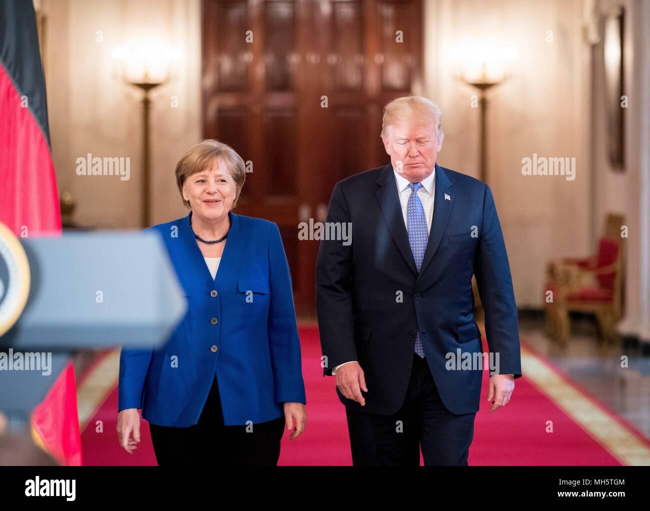 27 April 2018, USA, Washington: German Chancellor Angela Merkel (CDU) and US President Donald Trump arrive to the White House. Photo: Kay Nietfeld/dpa - Stock Image