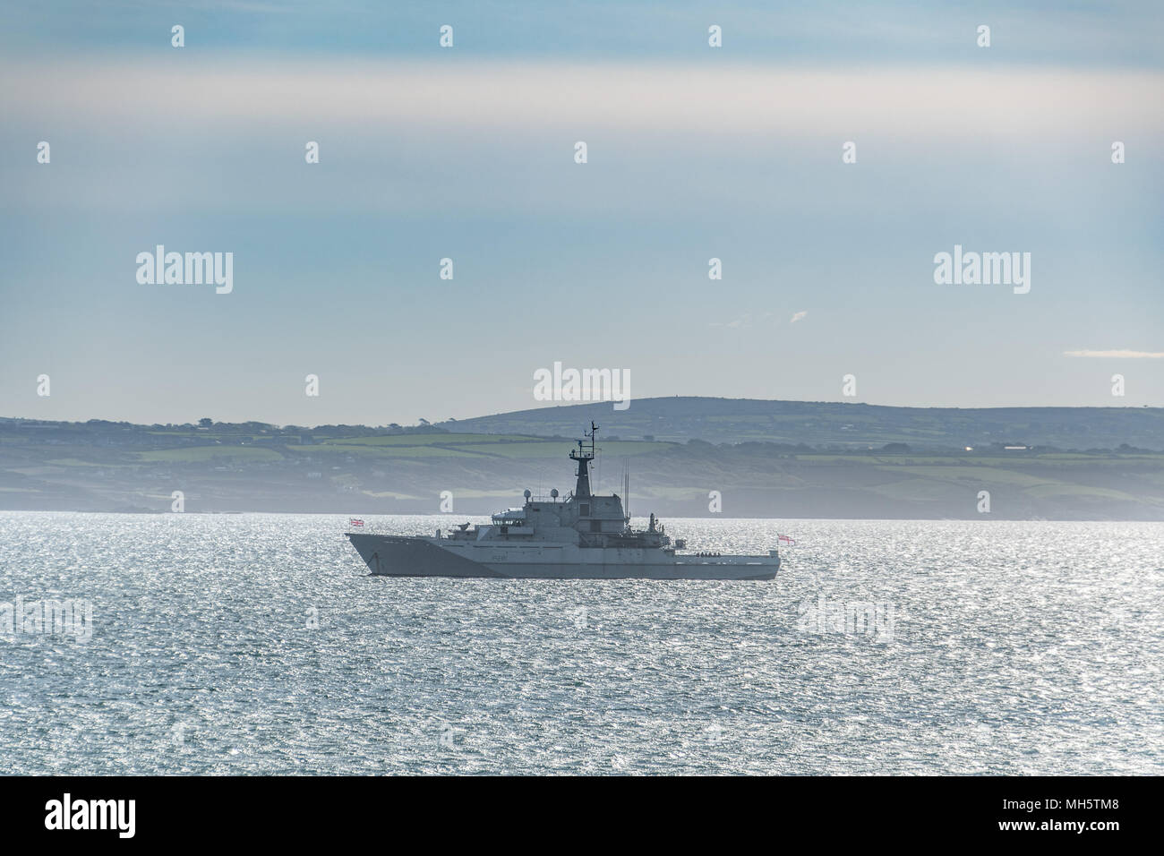 Newlyn, Cornwall, UK.  30th April 2018. UK Weather. HMS Tyne out in a sunny Mounts Bay this morning.  HMS Tyne is the first of a trio of River-class patrol ships built to safeguard the fishing stocks in UK.  The ship is one of the busiest in the Fleet as she spends on average nine out of every ten days of the year at sea. Credit: Simon Maycock/Alamy Live News - Stock Image