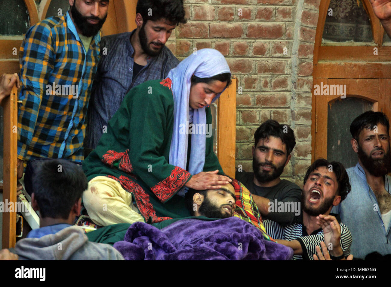 Pulwama, Kashmir. 30th Apr, 2018. Mourners surround the body of a man killed during protests in Pulwama, south of Srinagar, the summer capital of Indian controlled Kashmir. Protests erupted after police reportedly killed two militants during a gunfight. Credit: Faisal Khan/ZUMA Wire/Alamy Live News - Stock Image