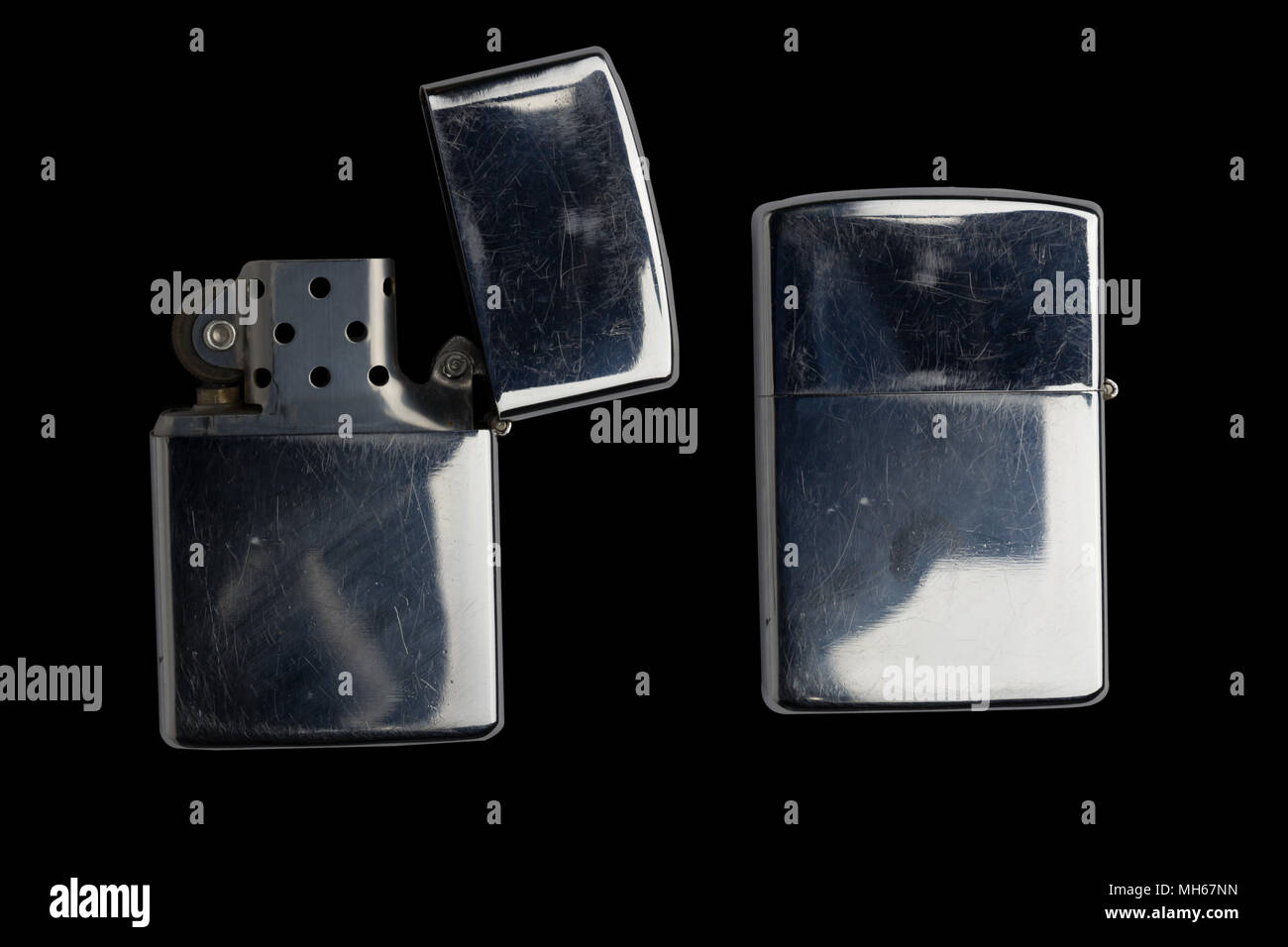 silver metal zippo lighter isolated on black - Stock Image