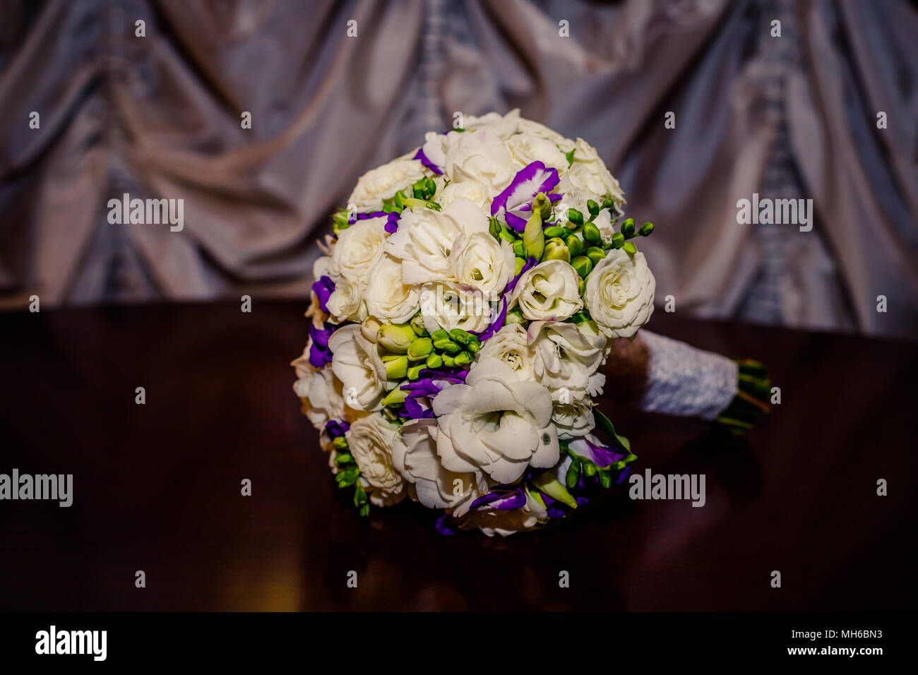 Beautiful bouquet with freesia flowers wedding flowers bouquet and beautiful bouquet with freesia flowers wedding flowers bouquet and eustomaisolated on wooden tablesianthus flowersviolet and white izmirmasajfo