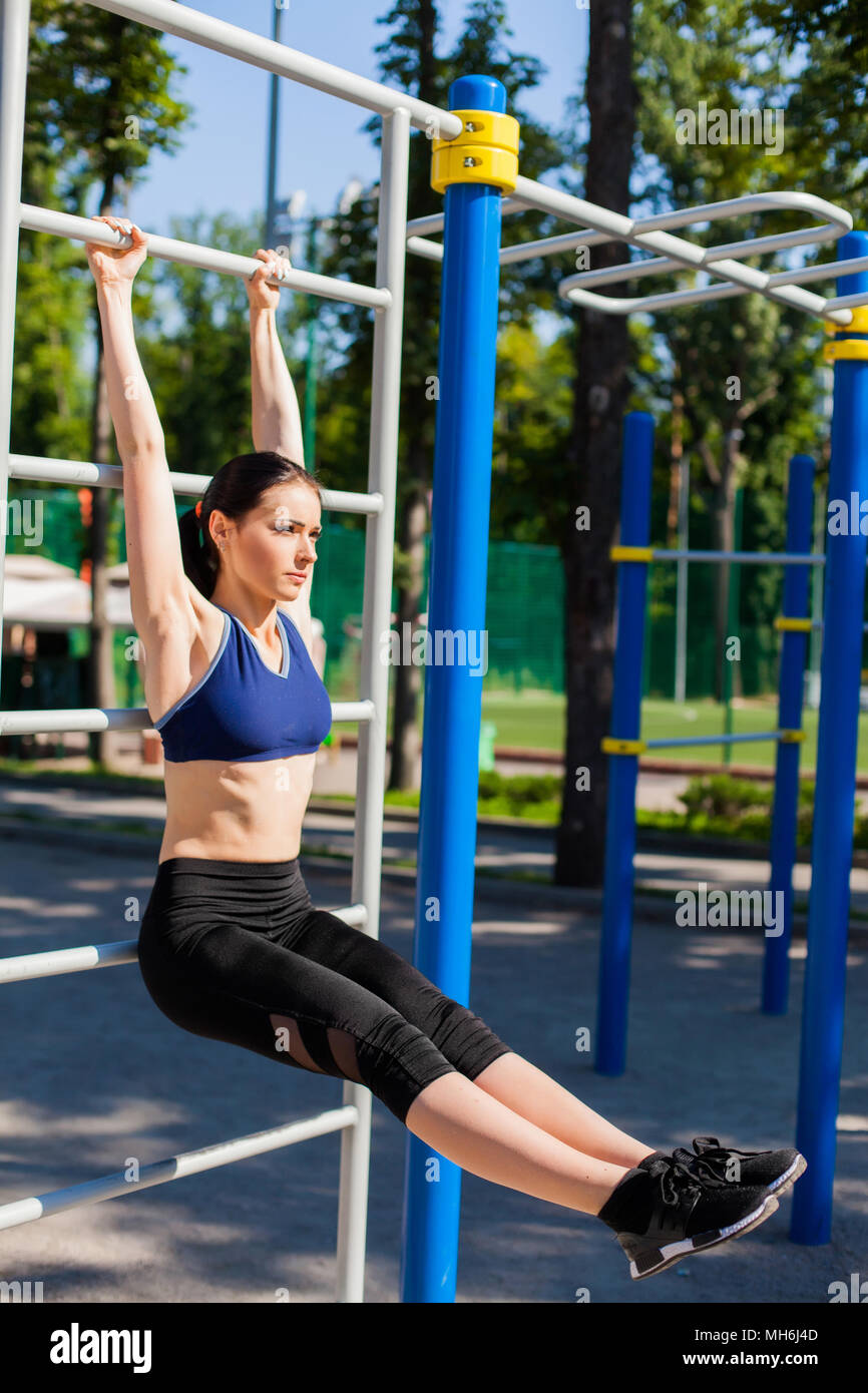 athletic woman on sport playground - Stock Image