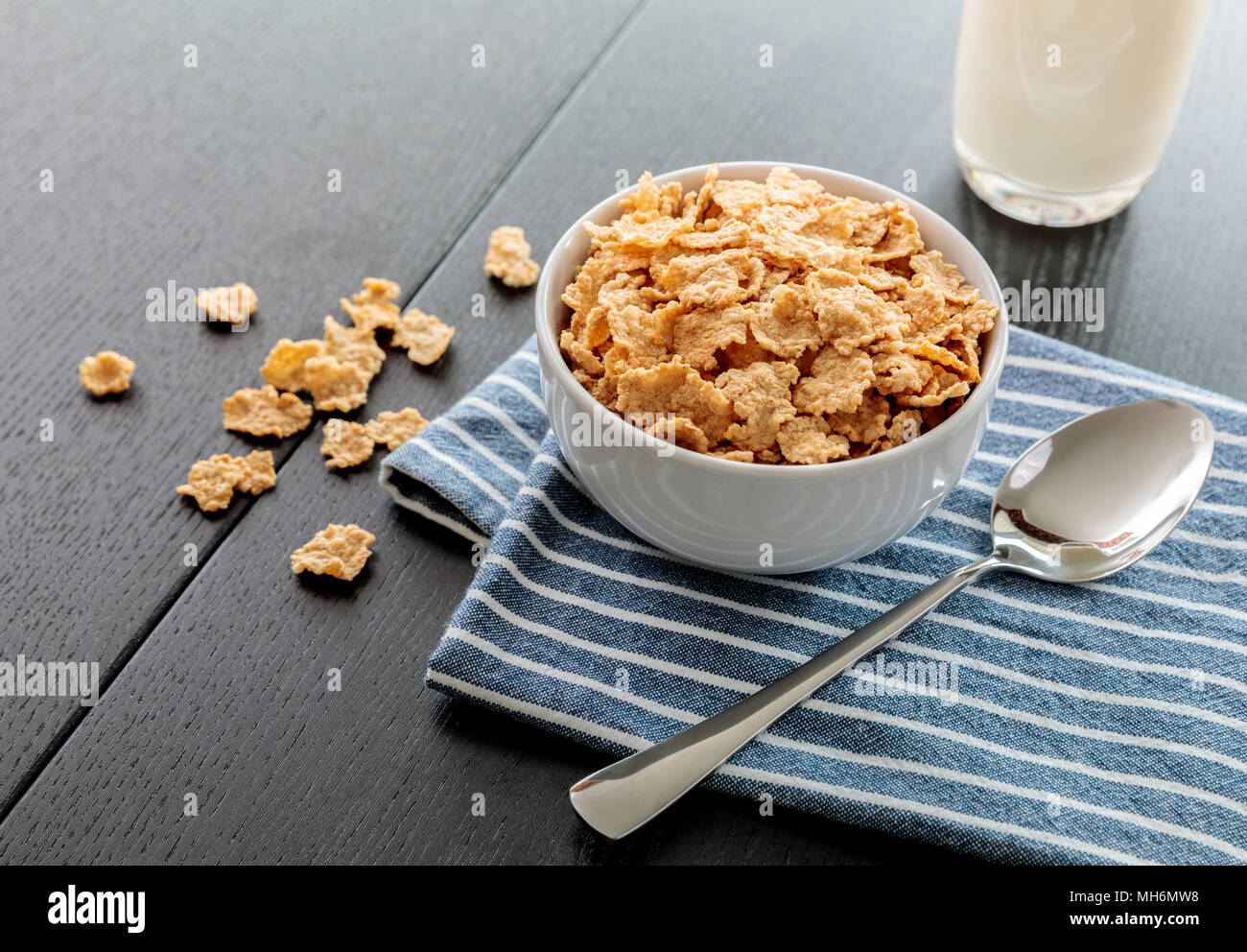 Healthy Corn Flakes with milk for Breakfast on table, food and drink - Stock Image