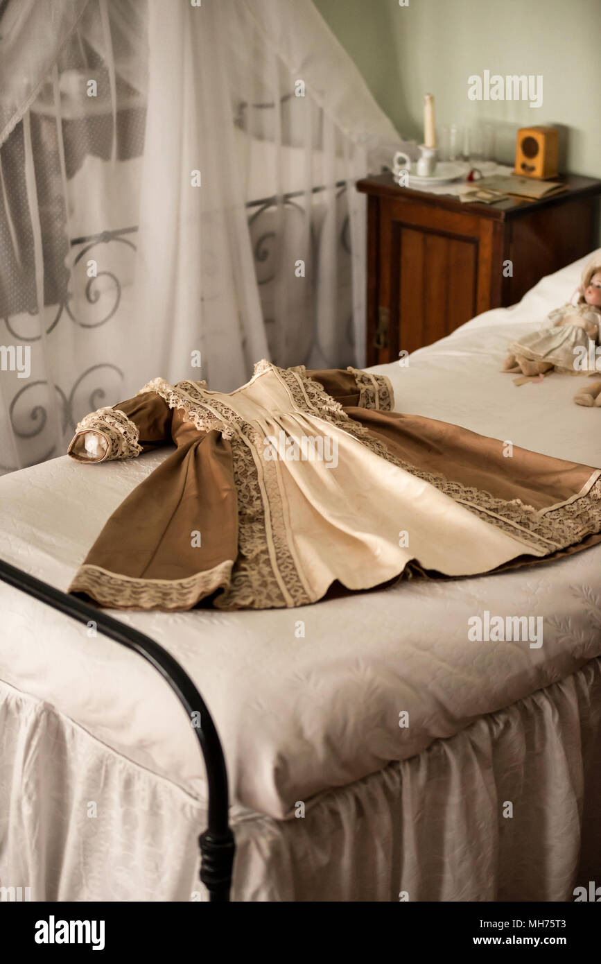 Children S Dress And Dolls On Bed In Vintage Victorian