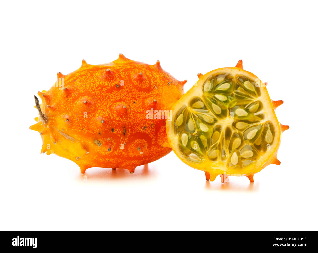 whole and half African Horned Melon on white background - Stock Image