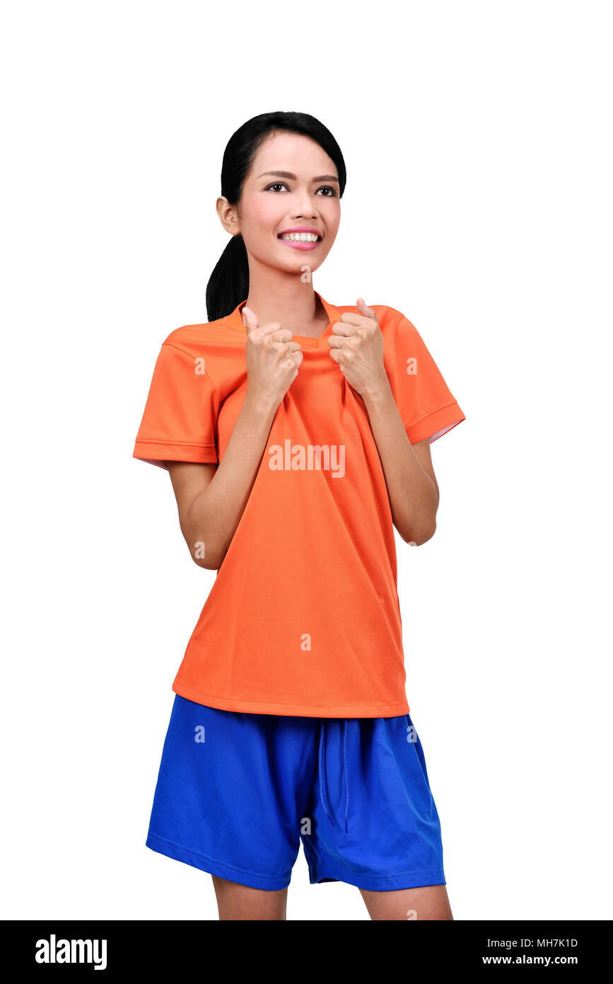 Happy asian female footballer celebrating her goal isolated over white background - Stock Image