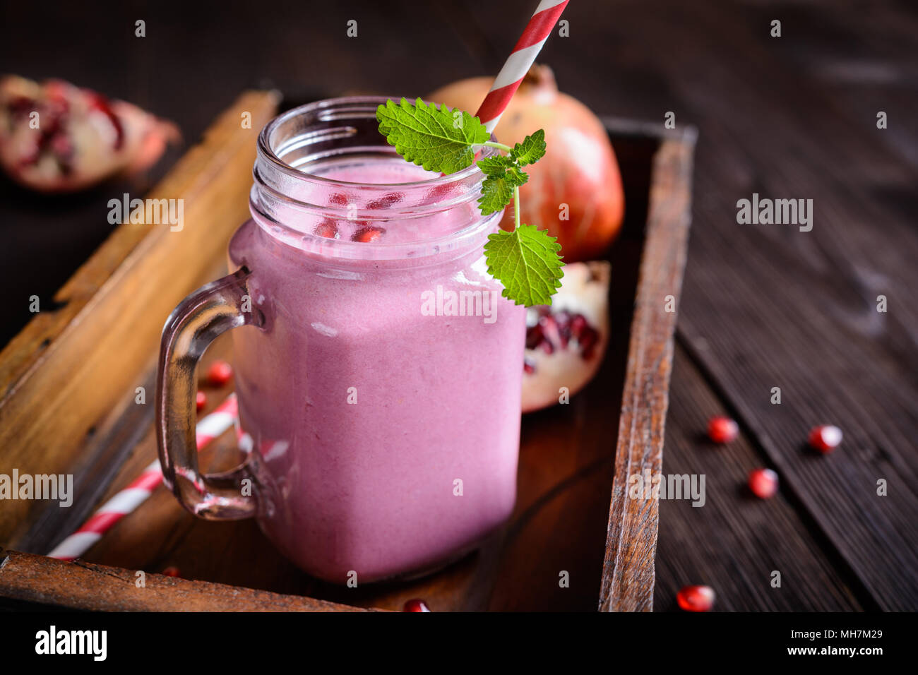 Refreshing pomegranate smoothie in a glass jar Stock Photo
