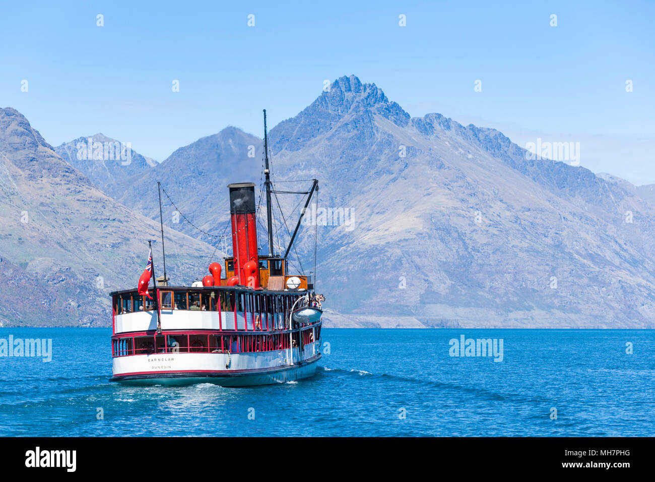 TSS Earnslaw Cruise on Lake Wakatipu to walter peak departing from the dock at Queenstown new zealand south island Queenstown South Island new zealand - Stock Image