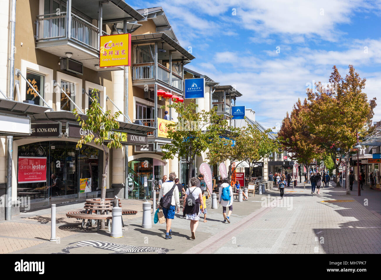 Queenstown South Island new zealand tourists in downtown Queenstown on a busy shopping street Beach street Queentown new zealand nz - Stock Image