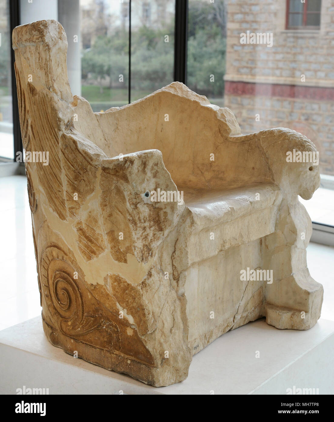 Marble throne. Throne from an earlier public building that was later used as an Episcopal throne in the Parthenon after its conversion into a Christian church in the 6th century AD. Dated between 3rd century BC and 2nd century BC. Acropolis Museum. Athens. Greece. - Stock Image
