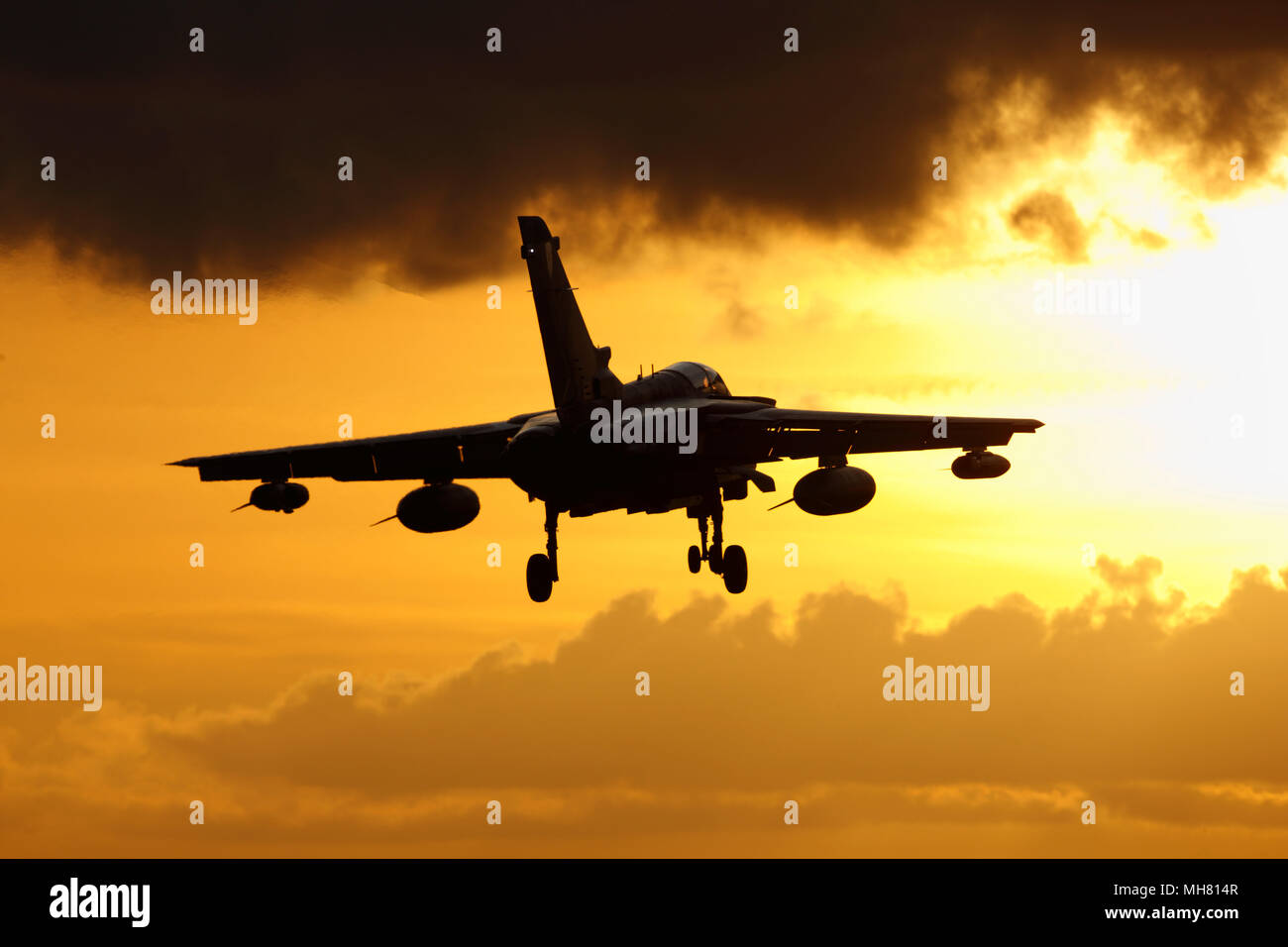 Royal Air Force Panavia Tornado GR4 combat aircraft at sunset. wheels down ready to land. The Tornado fleet are due to be retired in early 2019 Stock Photo