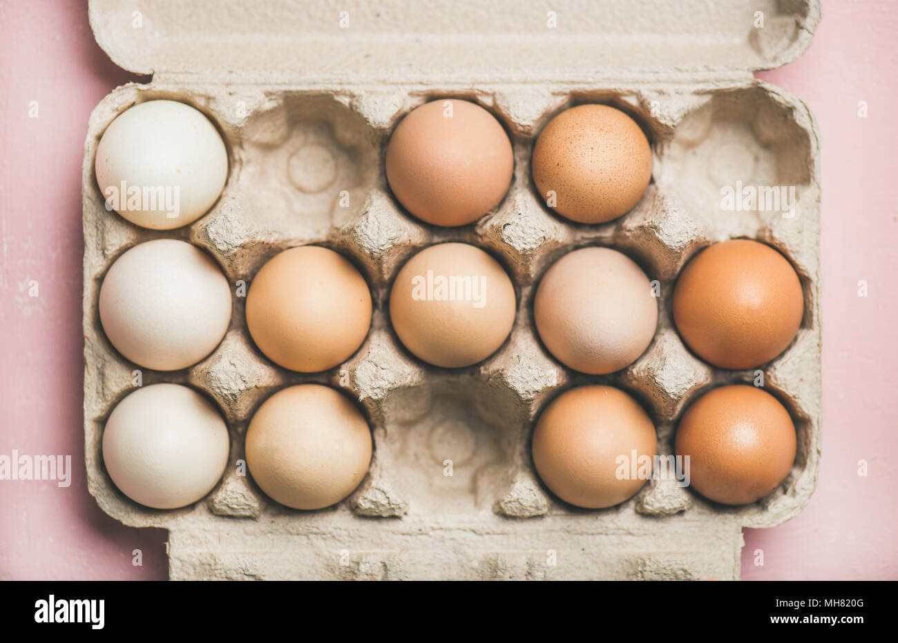 Natural colored eggs for Easter in box, horizontal composition - Stock Image