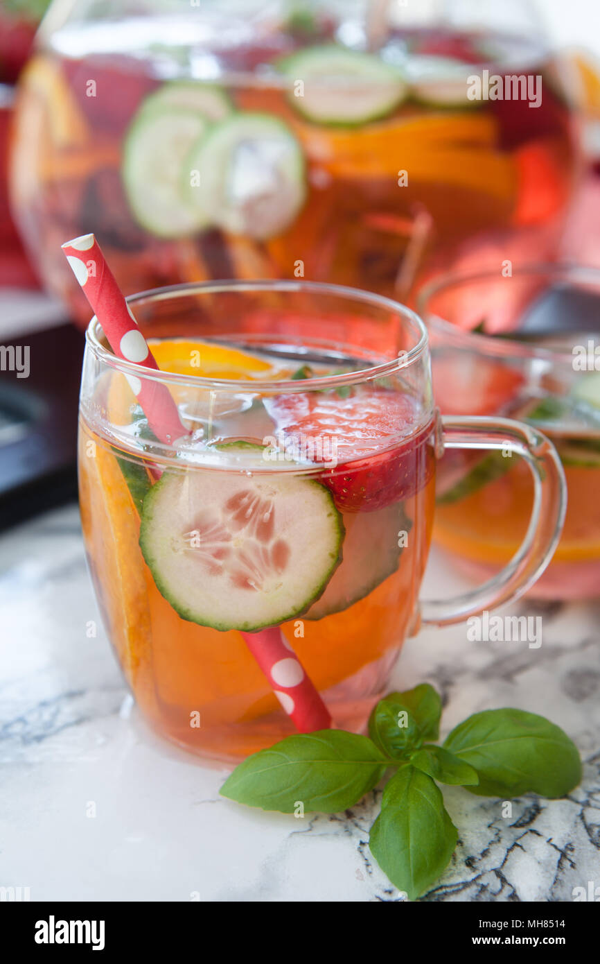 Homemade fruit punch with strawberry, orange and cucumber - Stock Image