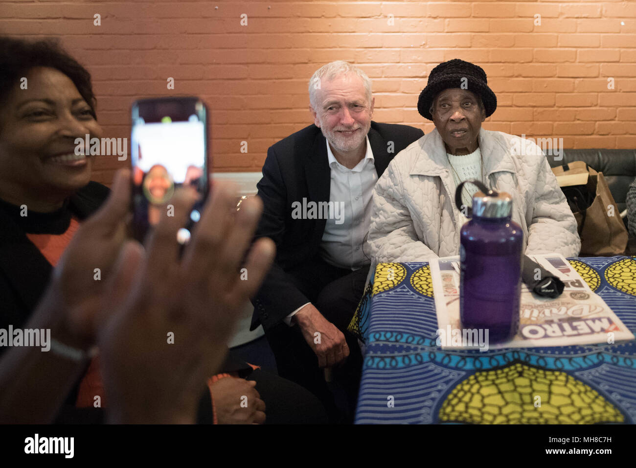Labour leader Jeremy Corbyn meets people from the Caribbean and the West Indies, members of the Stockwell Good Neighbours community group, at the Oval House Theatre in Kennington, south London. - Stock Image