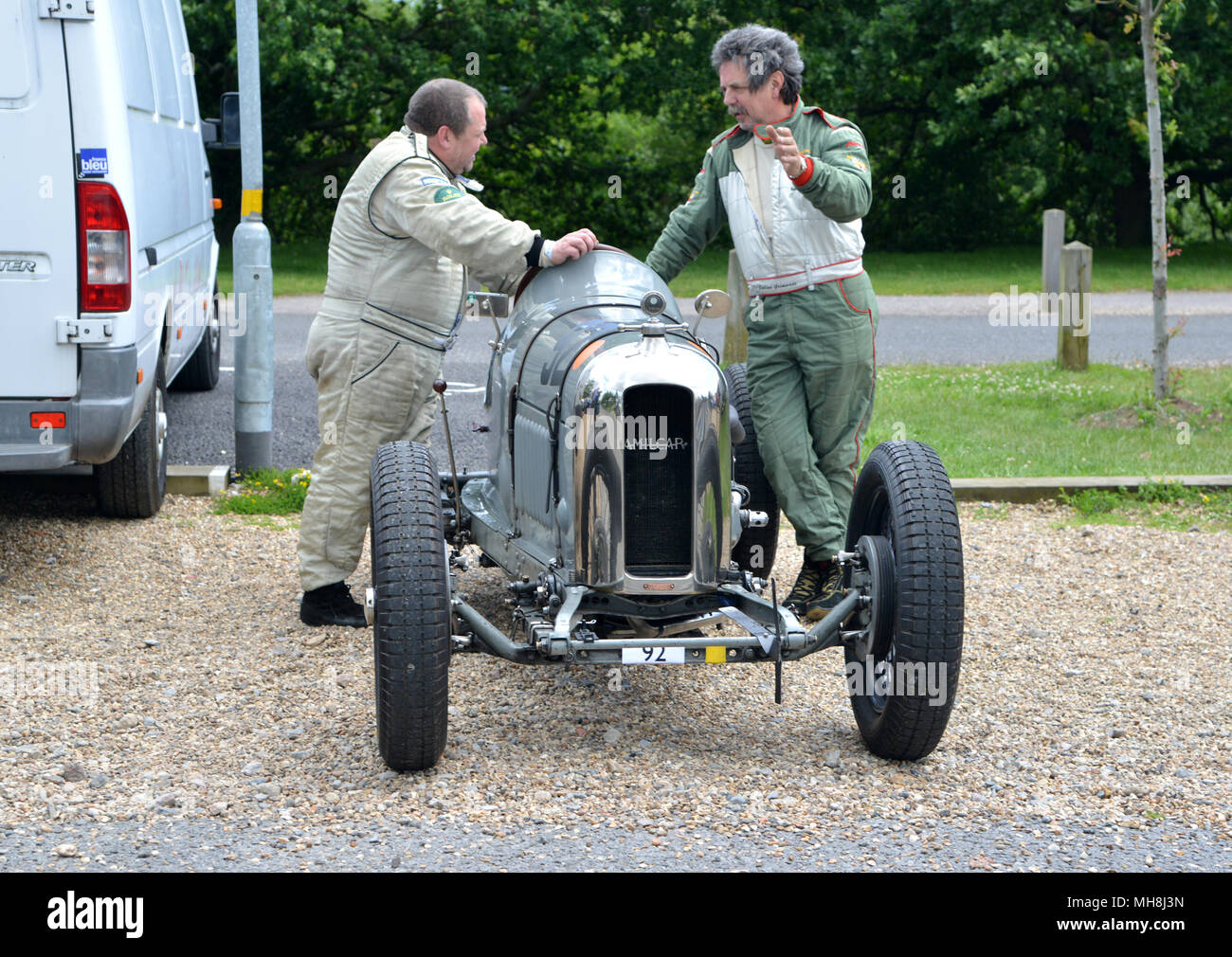 Drivers prepare aFrench pre war Amilcar racing car at Brooklands Stock Photo
