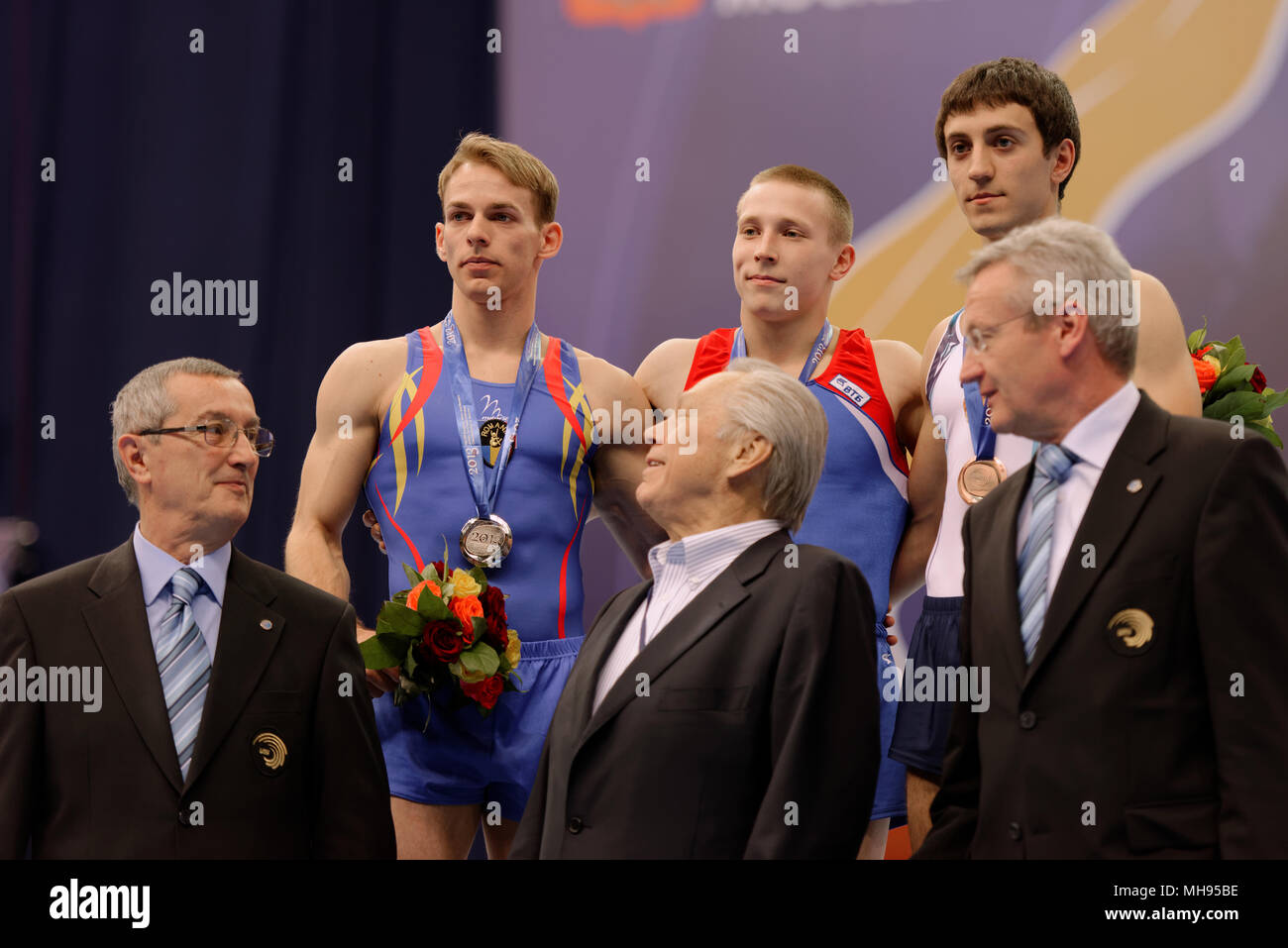 Koczi, Romania, left, Ablyazin, Russia, center, and Davtyan, Armenia during award ceremony on European Championships in Artistic Gymnastics - Stock Image