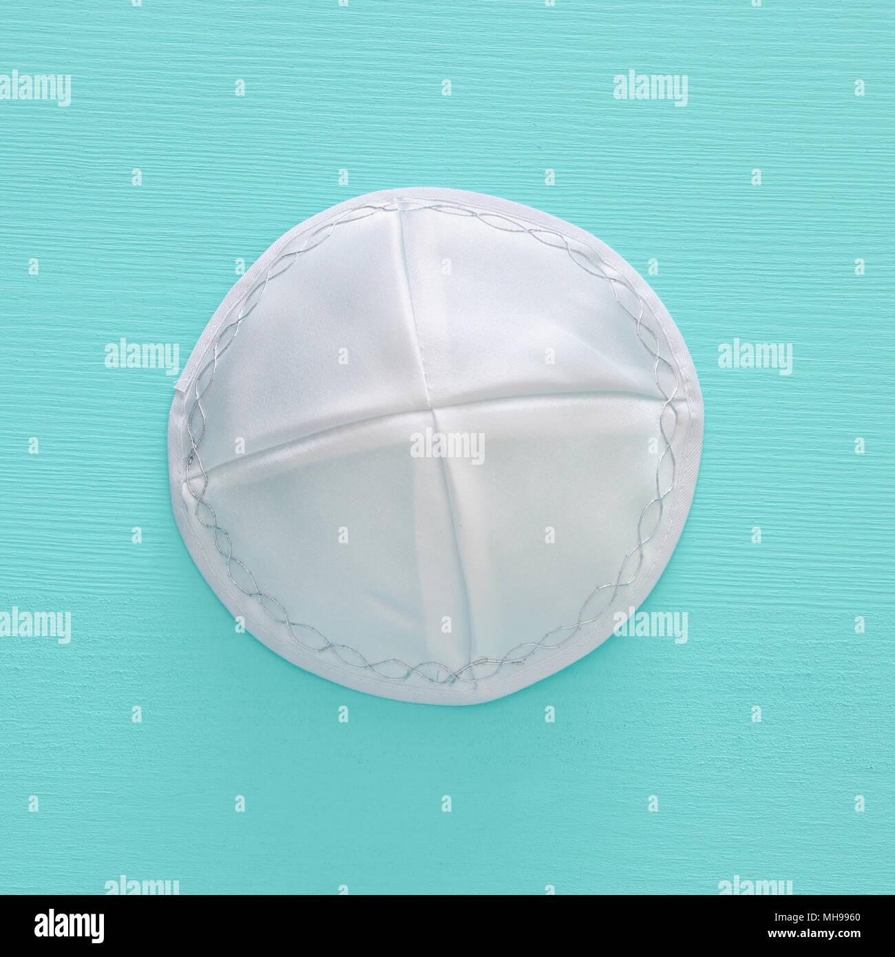a5002799ab1 Top view image of jewish Kippah yarmulke (hat). holidays and shabbat  concept -
