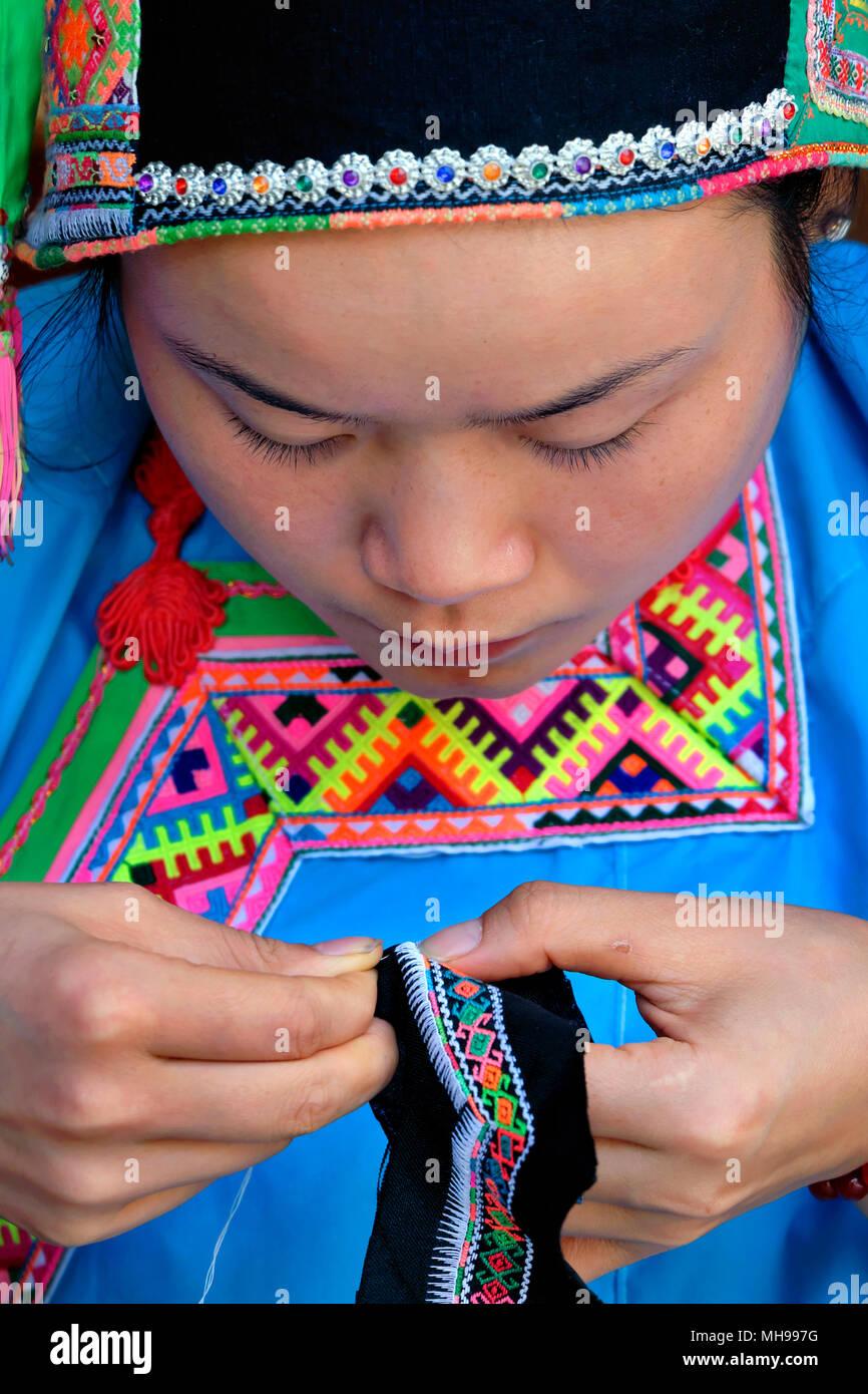 Dong minority woman wearing her national dress, Zhaoxing Village, Liping County, Guizhou Province, China - Stock Image