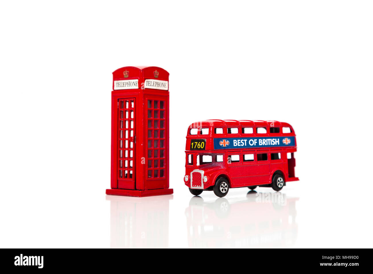 A Red London Doubledecker Bus and red telephone box. Isolated on white background - Stock Image