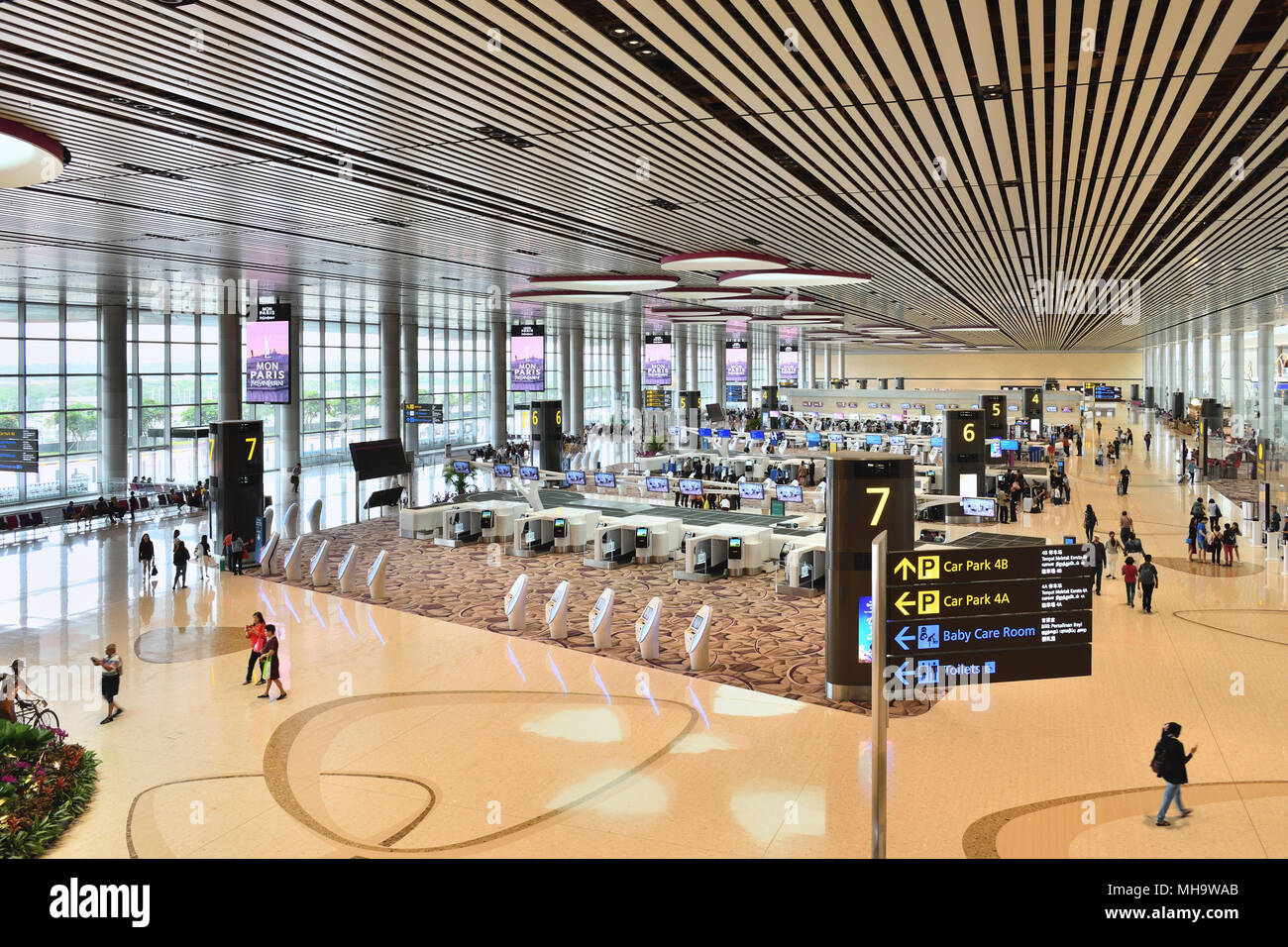 Singapore Changi International Airport, Terminal 4. The departure hall features new automatic check-in counters. - Stock Image