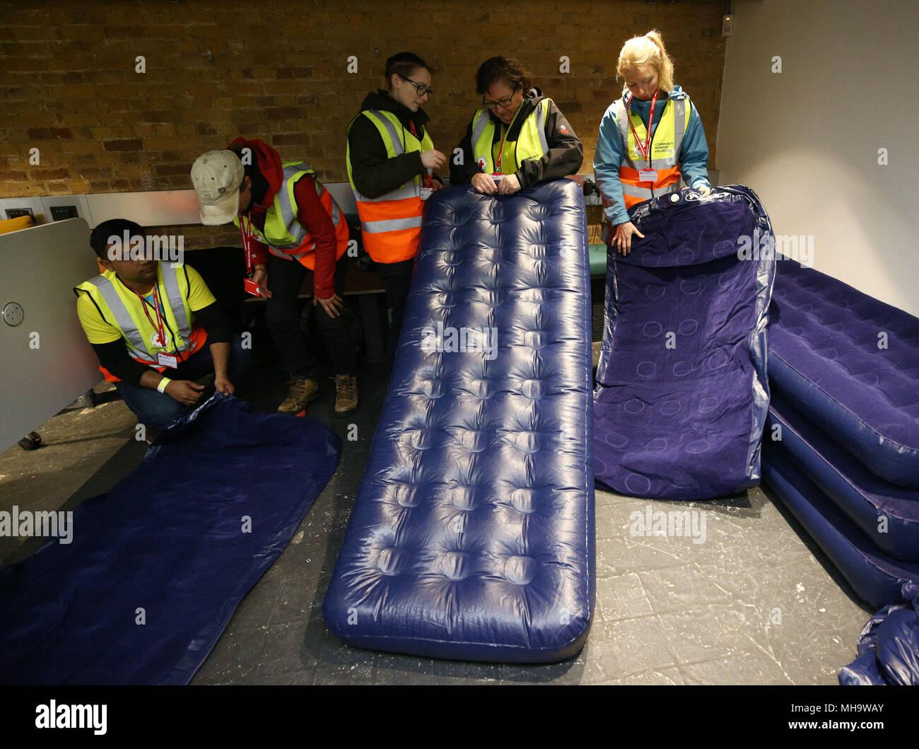 Volunteers Blowing Up Air Mattresses During An Emergency