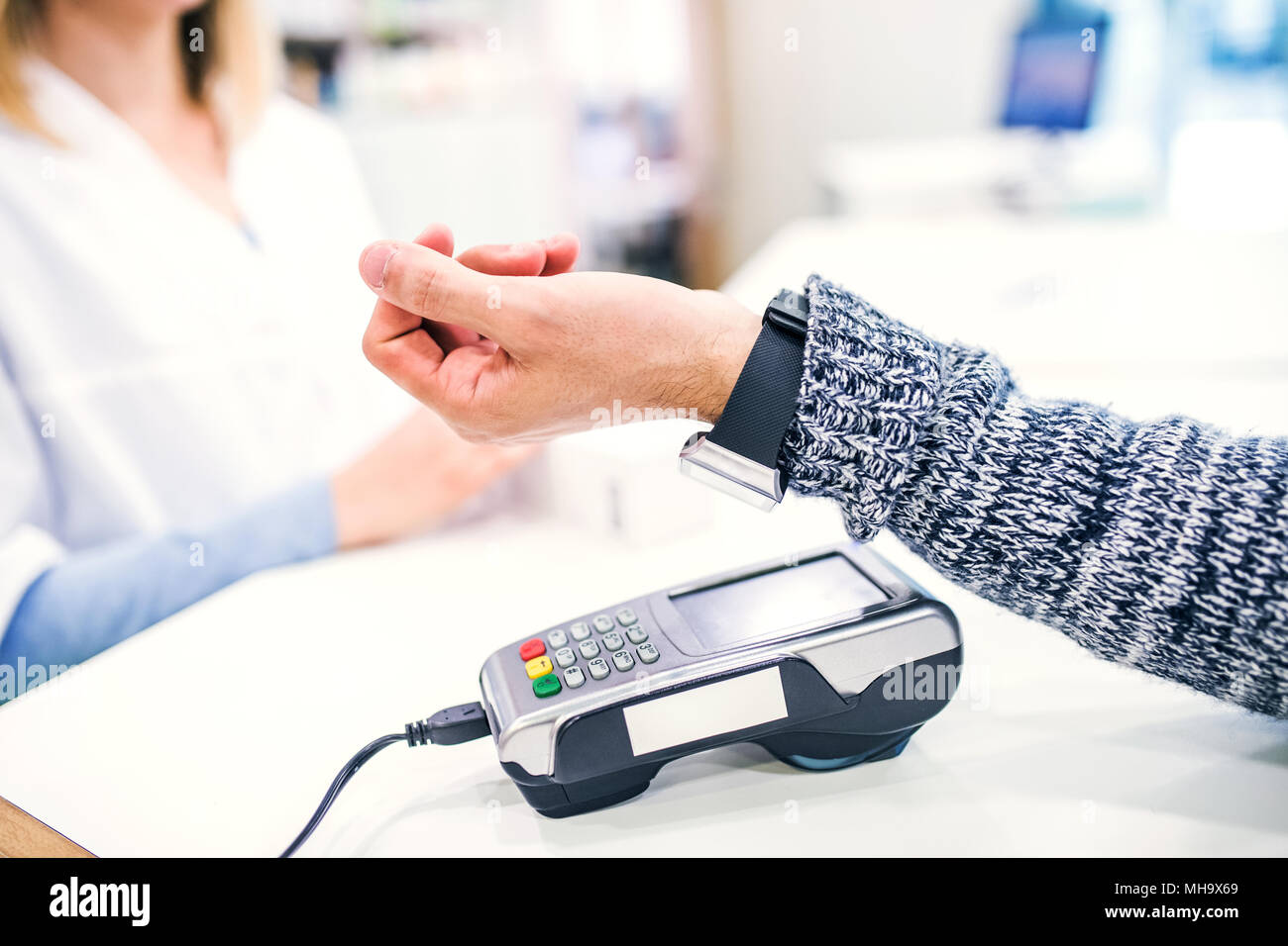 A customer making wireless or contactless payment using smartwatch. - Stock Image