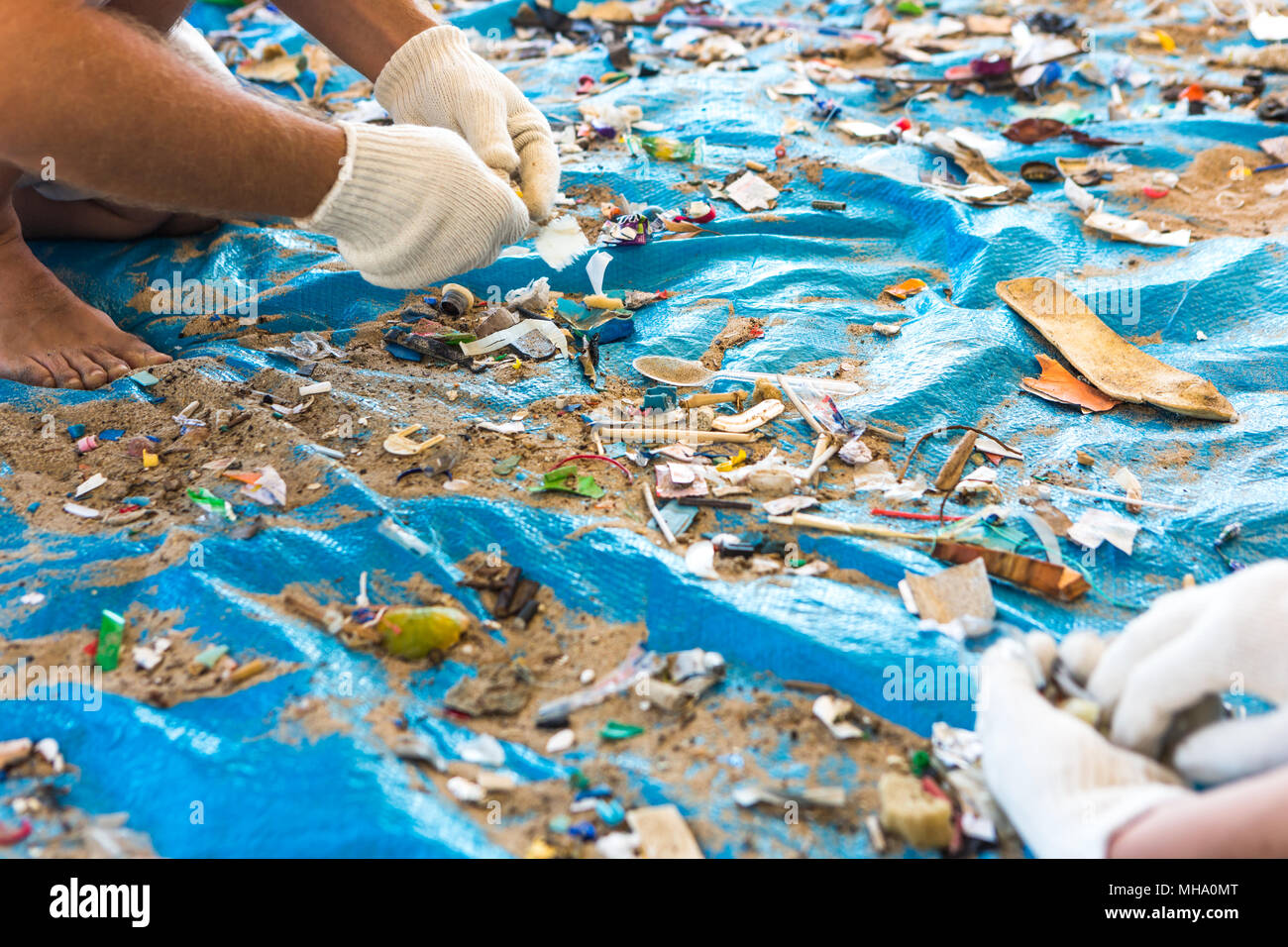 Beach Cleaning. Cleaning dirty beaches by the action of man. Sustainability of the planet and preservation of nature. - Stock Image