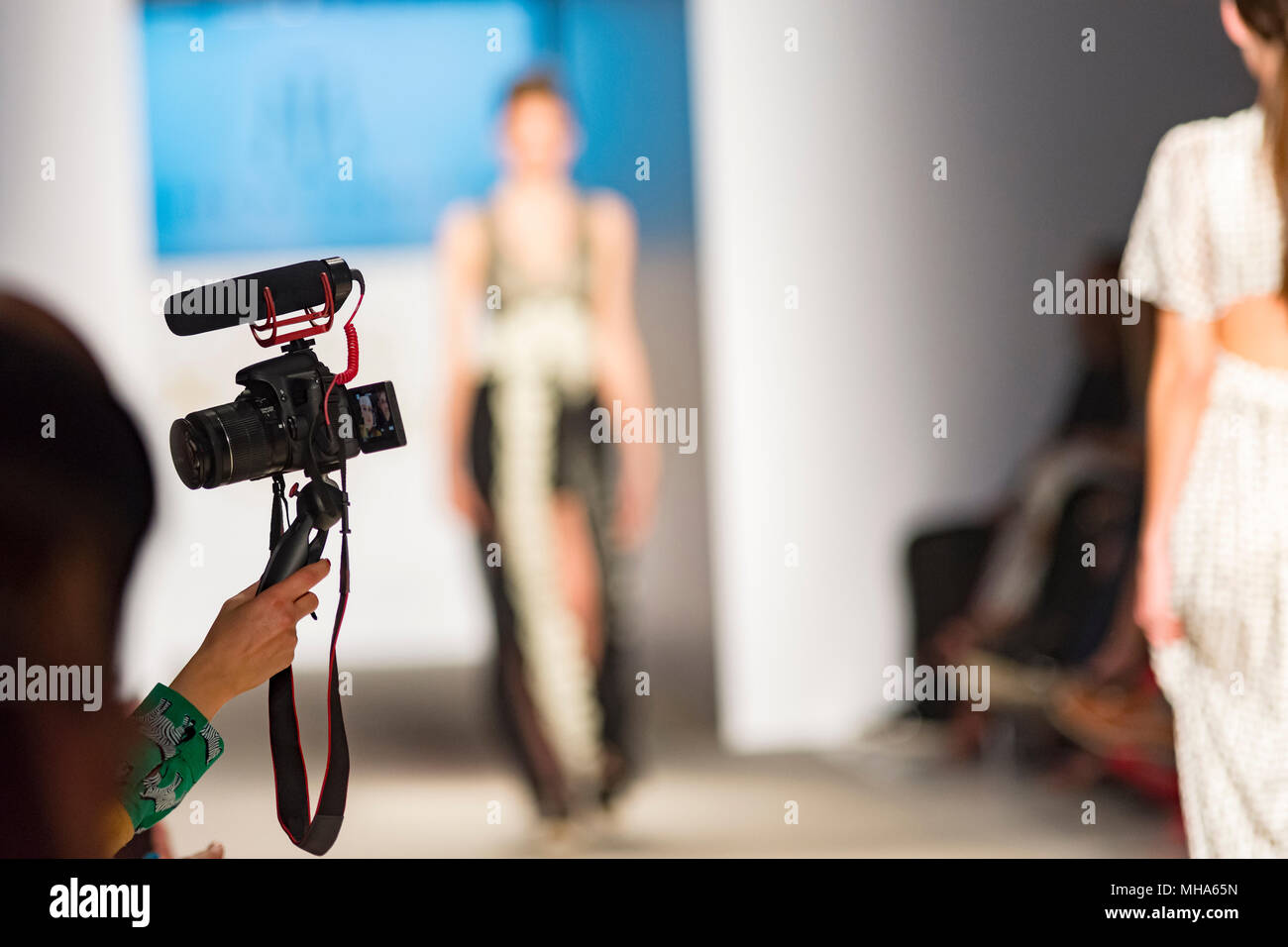 people from audience filming them self in a fashion show - Stock Image