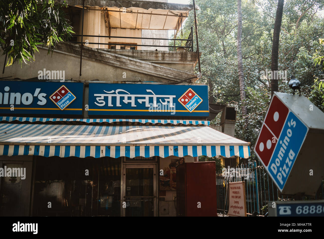 an Indian domino's pizza on a street corner in Mumbai, India - Stock Image