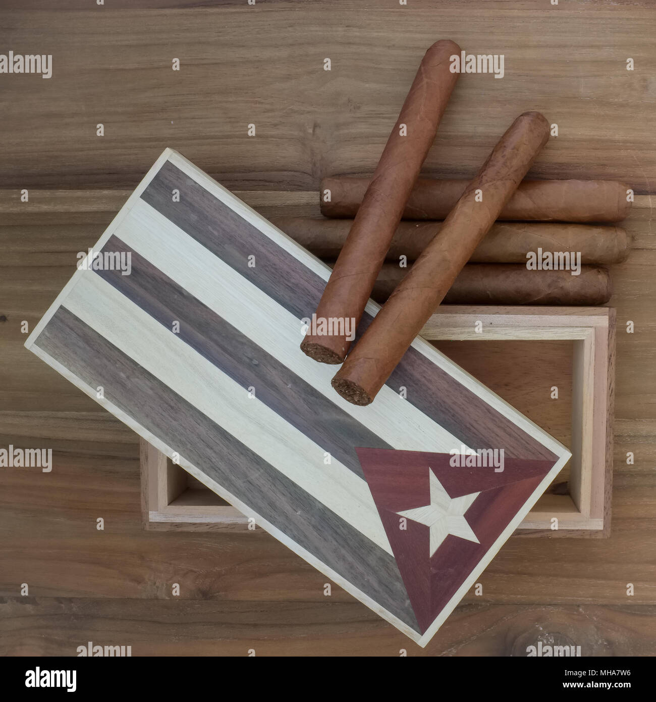 Studio Scene Of Cuban Cigars And Vintage Cigar Box On Old Wooden