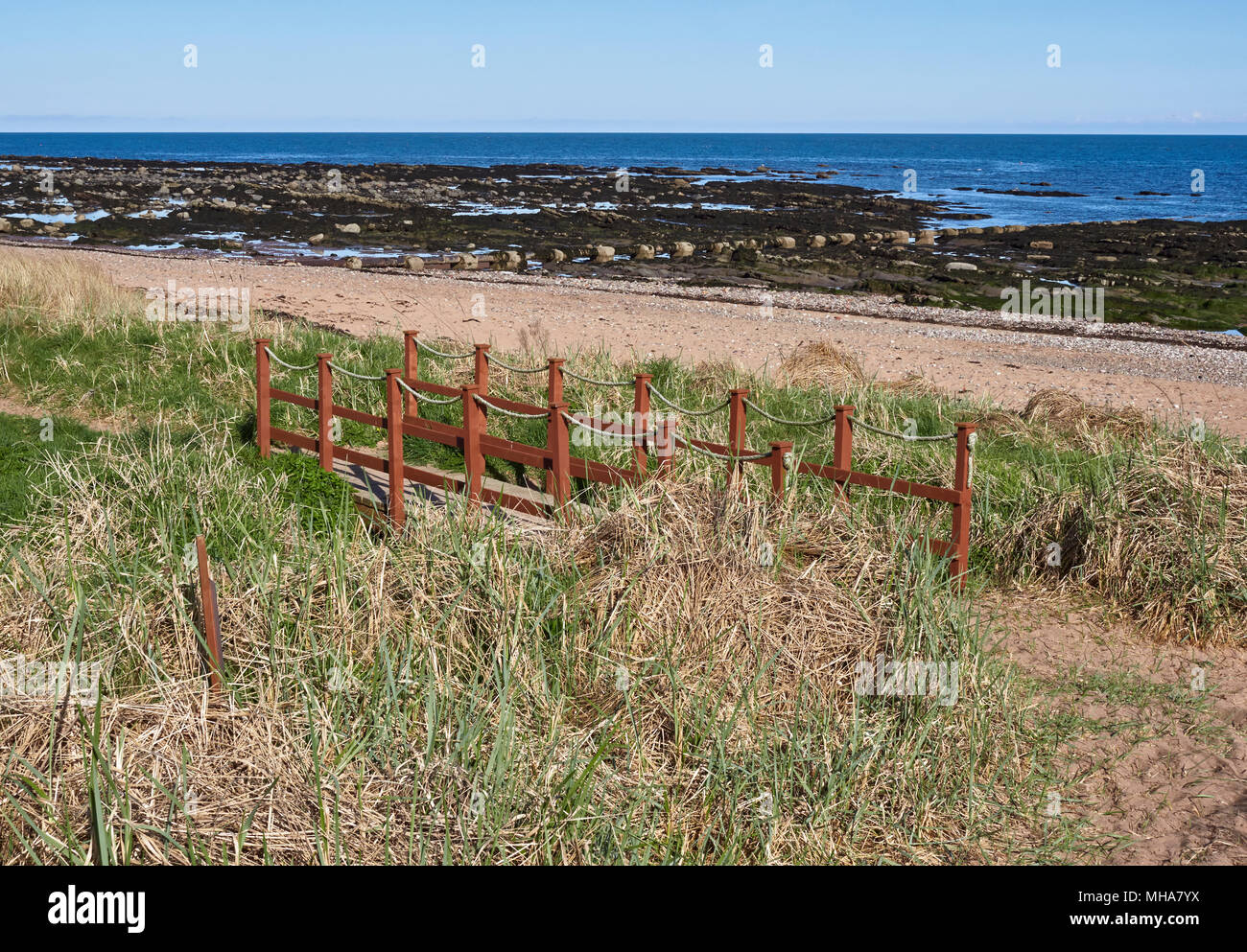 A small Wooden Bridge on the North East Scotland Coastal Path midway between Arbroath and East Haven. Angus, Scotland. Stock Photo