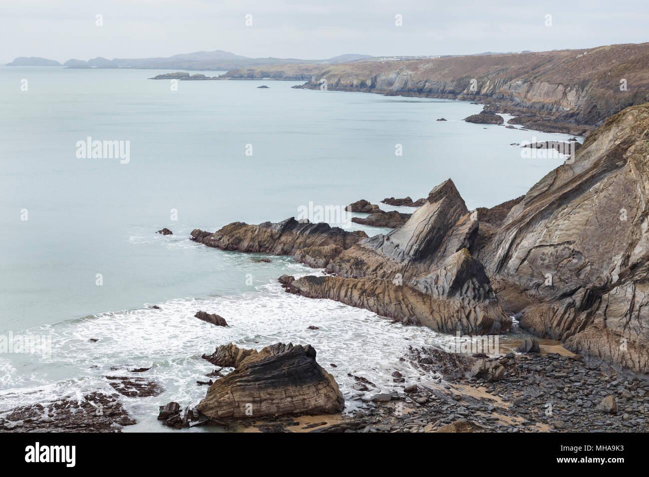 Moody coastline of Pembrokshire, Wales, seen from coast path. Stock Photo