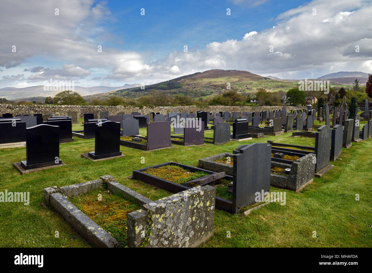 St Cedol's Graveyard, Pentir, North Wales, with the mountain of Moel y Ci in the background. Stock Photo