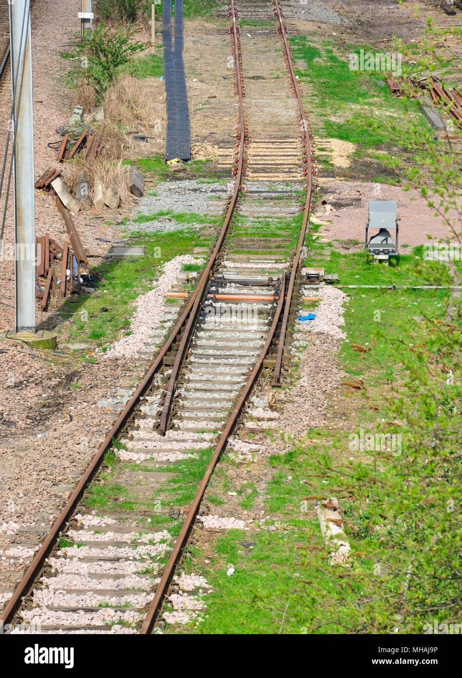 Catch point on old railway siding, Hitchin, Hertfordshire, England, UK - Stock Image