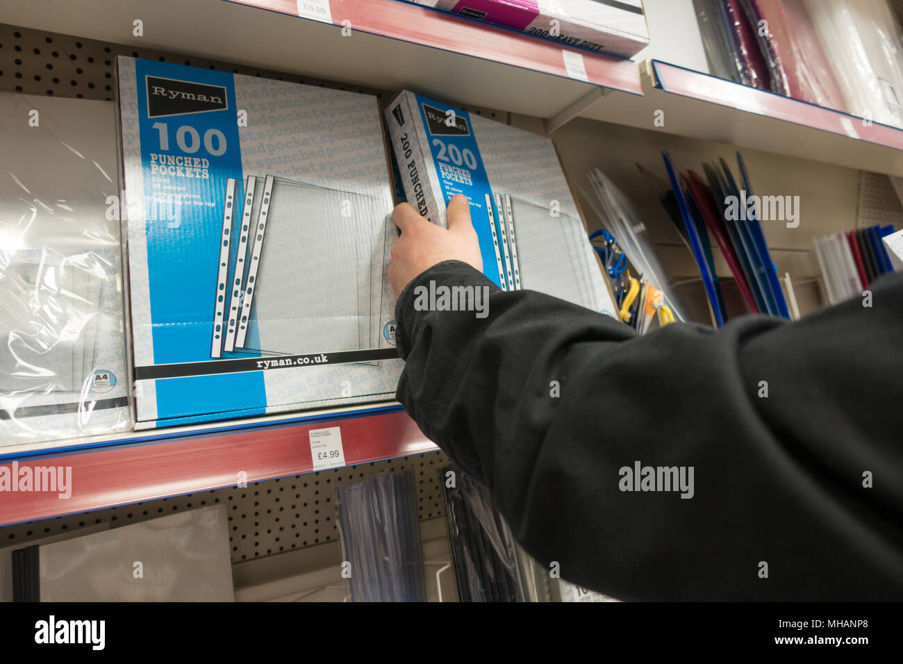 buying stationary in a shop - Stock Image