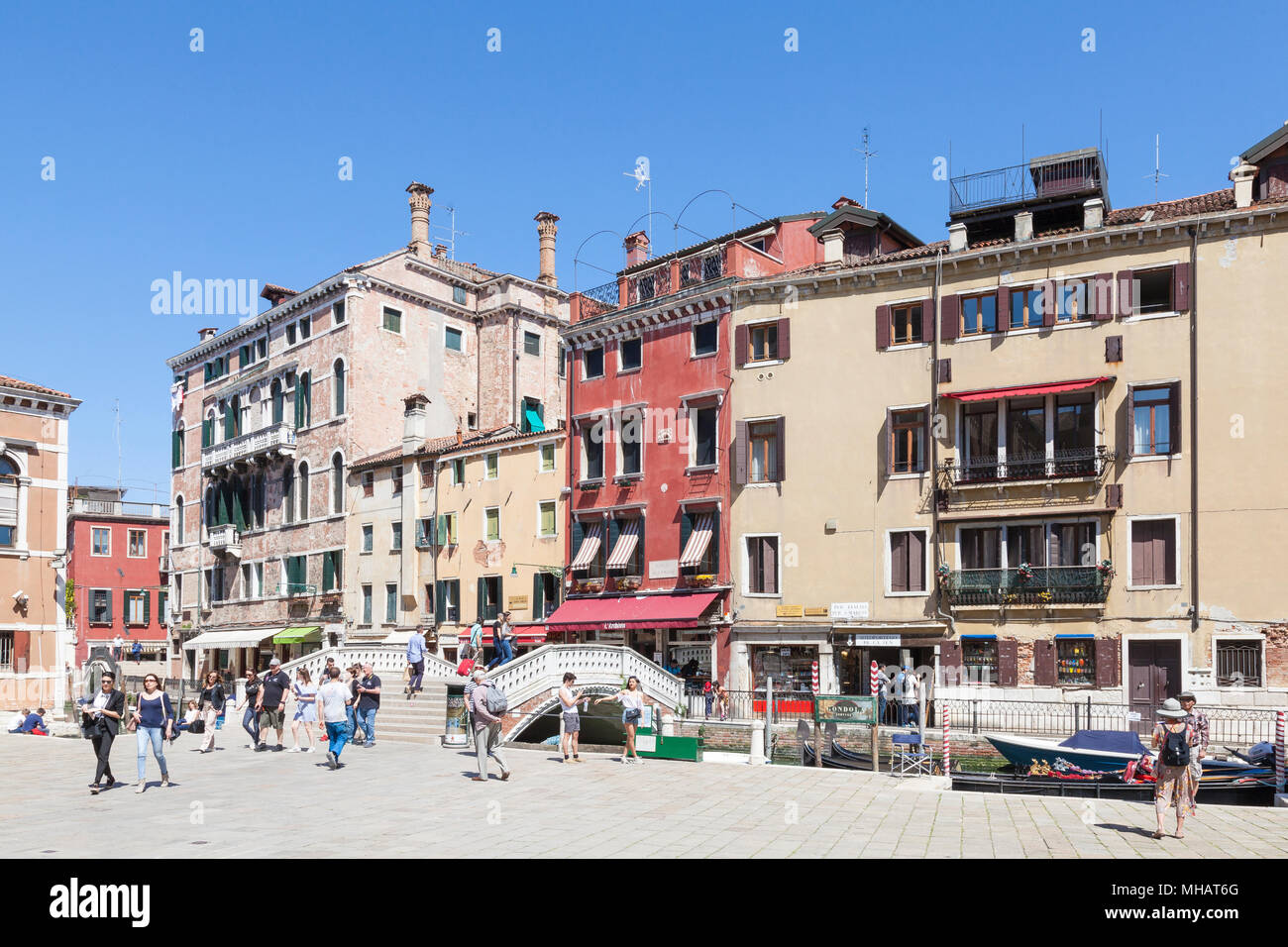 Colorful buildings and bridge on Campo dei Frari, San Polo, Venice, Veneto, Italy with tourists in spring - Stock Image