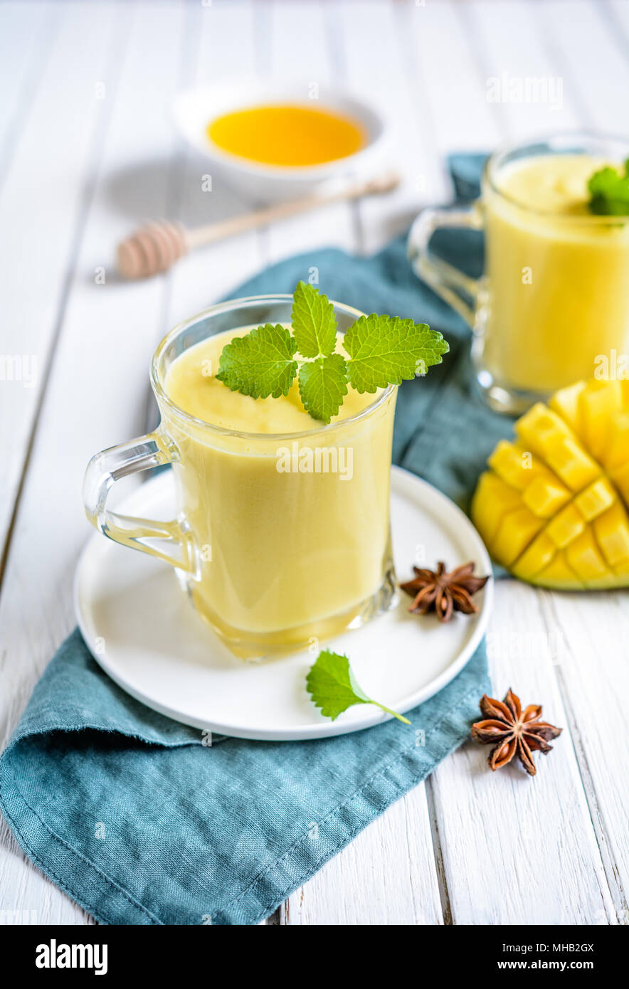 Mango Lassi - traditional Indian yoghurt drink in a glass jars - Stock Image